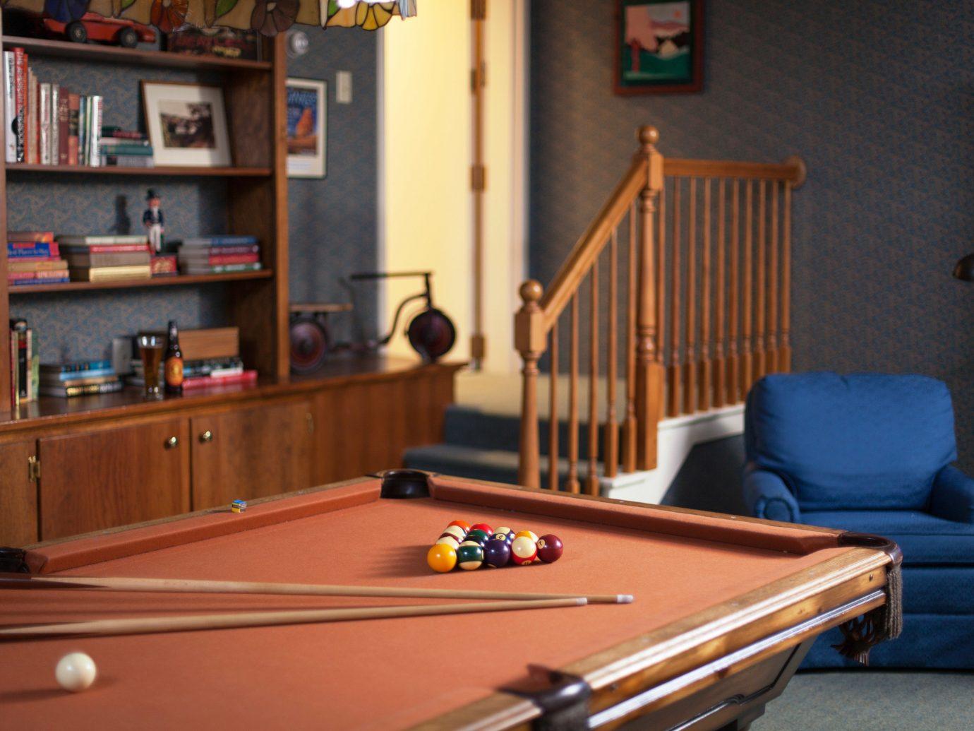 Jetsetter Guides indoor recreation room billiard room carom billiards cue sports floor room Pool shelf Living furniture games poolroom pool table table indoor games and sports billiard table