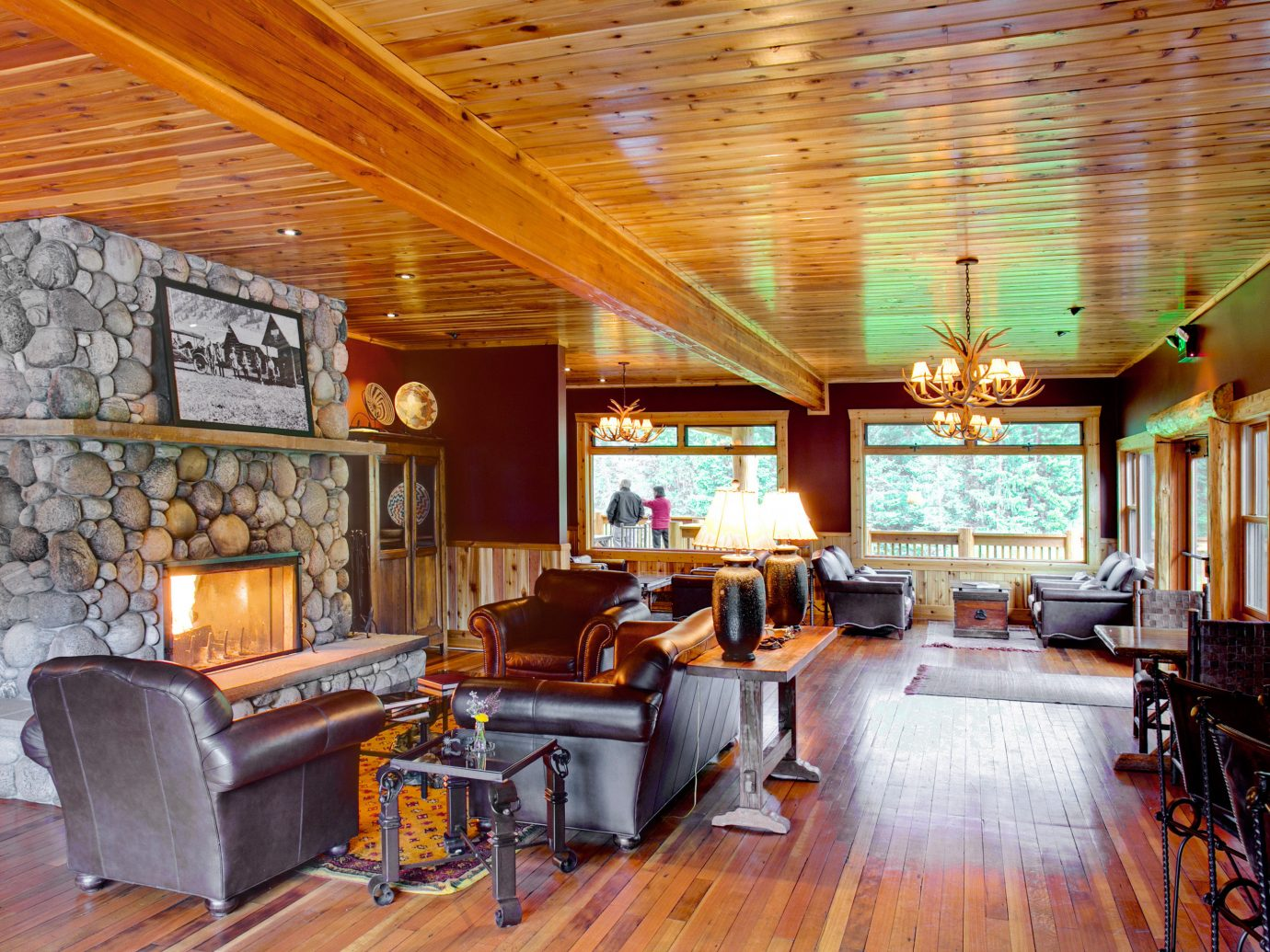Country Fireplace Glamping Hotels Lodge Lounge Montana Outdoors + Adventure Ranch Rustic Scenic views Trip Ideas indoor floor ceiling Living room property recreation room estate living room home furniture interior design real estate wood Lobby cottage mansion log cabin area