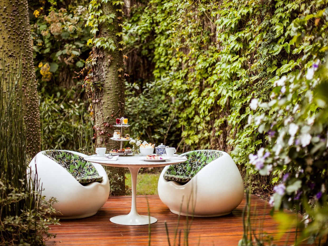 Boutique Hotels Luxury Travel tree outdoor Garden plant leaf table grass backyard outdoor structure landscaping area Forest wooded