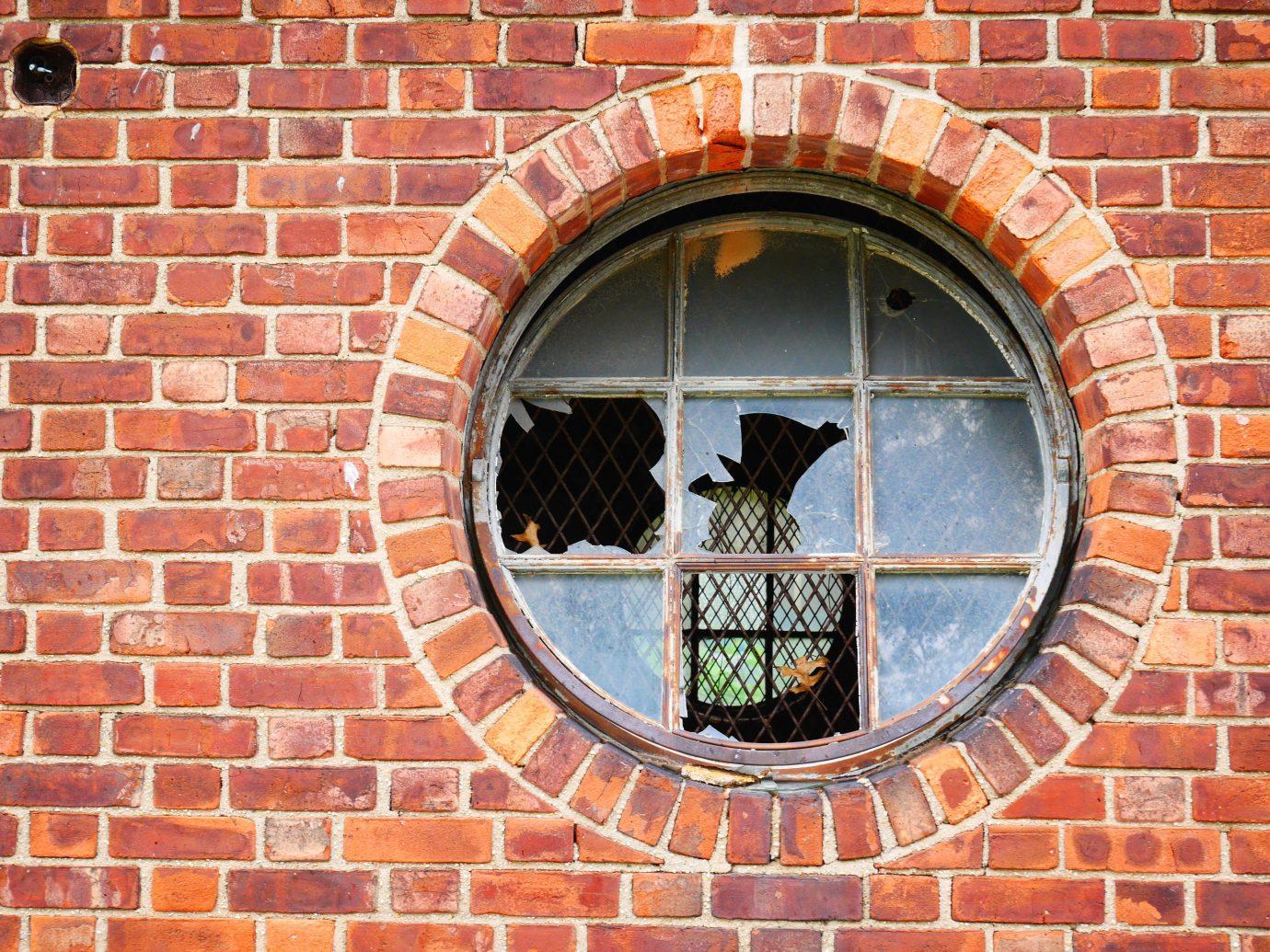 Offbeat outdoor brickwork brick building wall road surface window art facade material arch building material