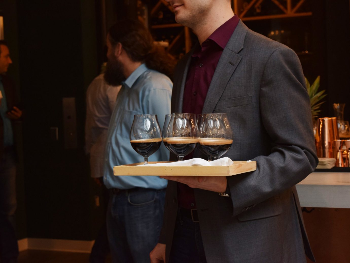 Person carrying glasses of beer at Terra in Boston