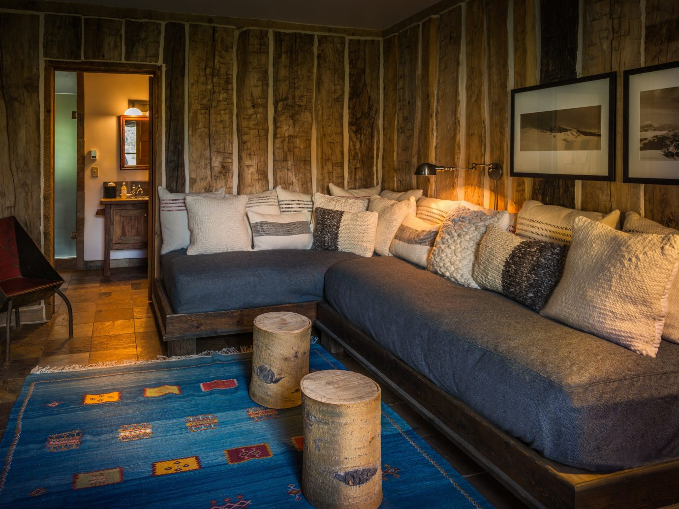 Boutique Hotels Fall Travel Hotels Outdoors + Adventure sofa Living indoor room floor living room interior design Suite furniture ceiling couch home real estate house seat