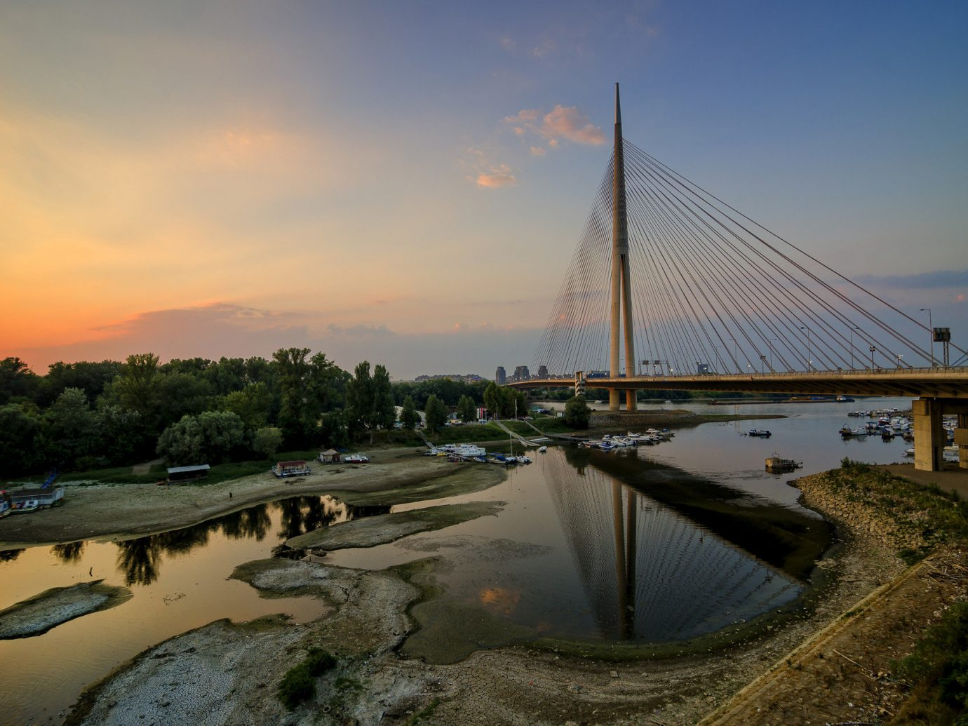 Trip Ideas sky outdoor water bridge River reflection cloud Sea Sunset morning dusk evening Coast Nature dawn cable stayed bridge sunrise bay sunlight nonbuilding structure cityscape shore land several distance