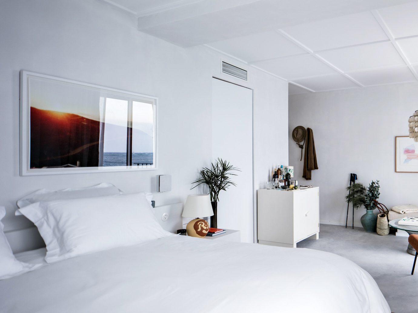 Hotels indoor wall bed room white ceiling interior design Suite Bedroom home pillow real estate bed frame interior designer furniture