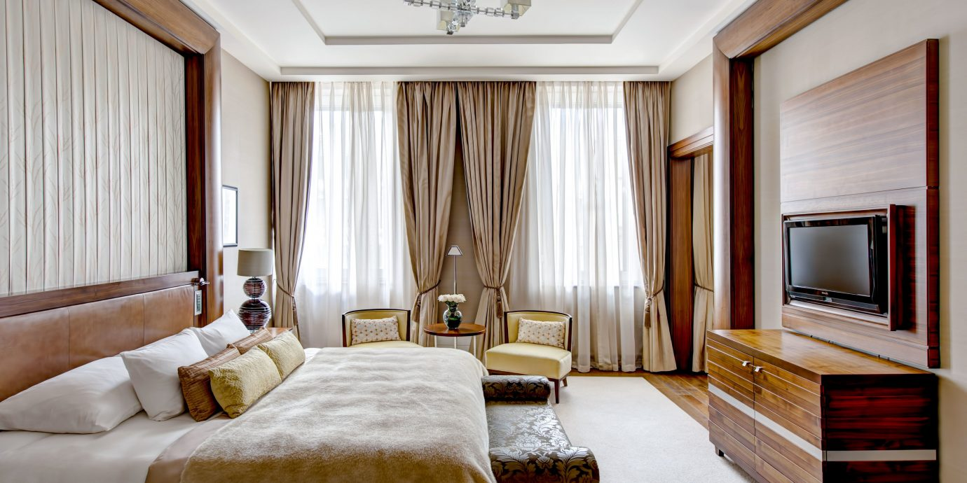 Arts + Culture Hotels Jetsetter Guides Luxury Travel indoor bed window floor room wall hotel Bedroom Suite interior design ceiling real estate window treatment window covering interior designer curtain estate decorated tan