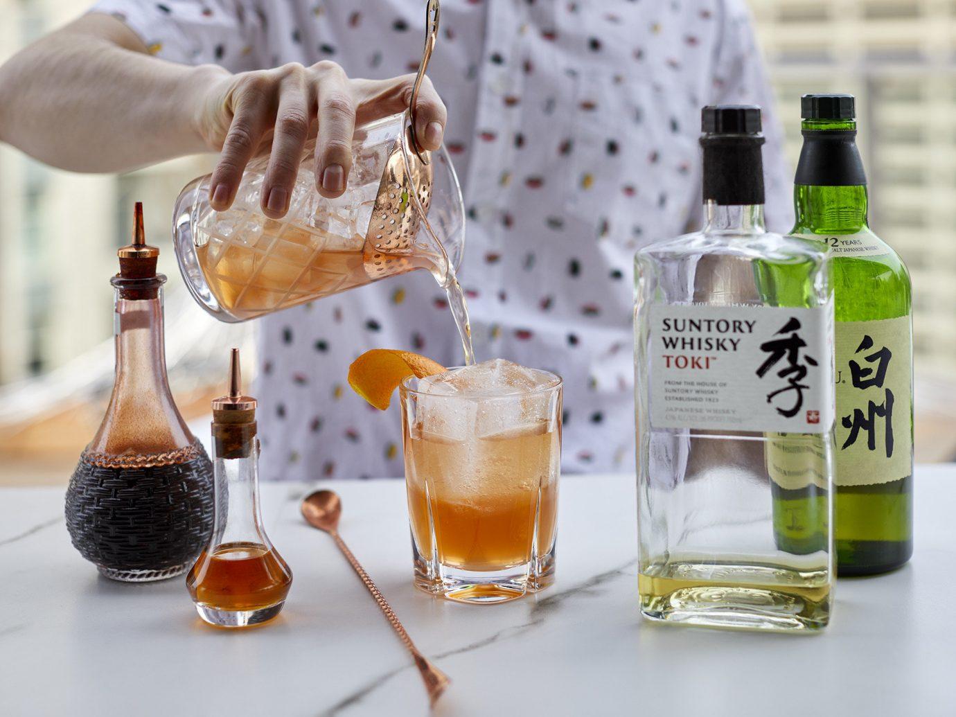 Offbeat bottle table Drink liqueur distilled beverage alcoholic beverage cocktail beer cocktail barware caipirinha dessert