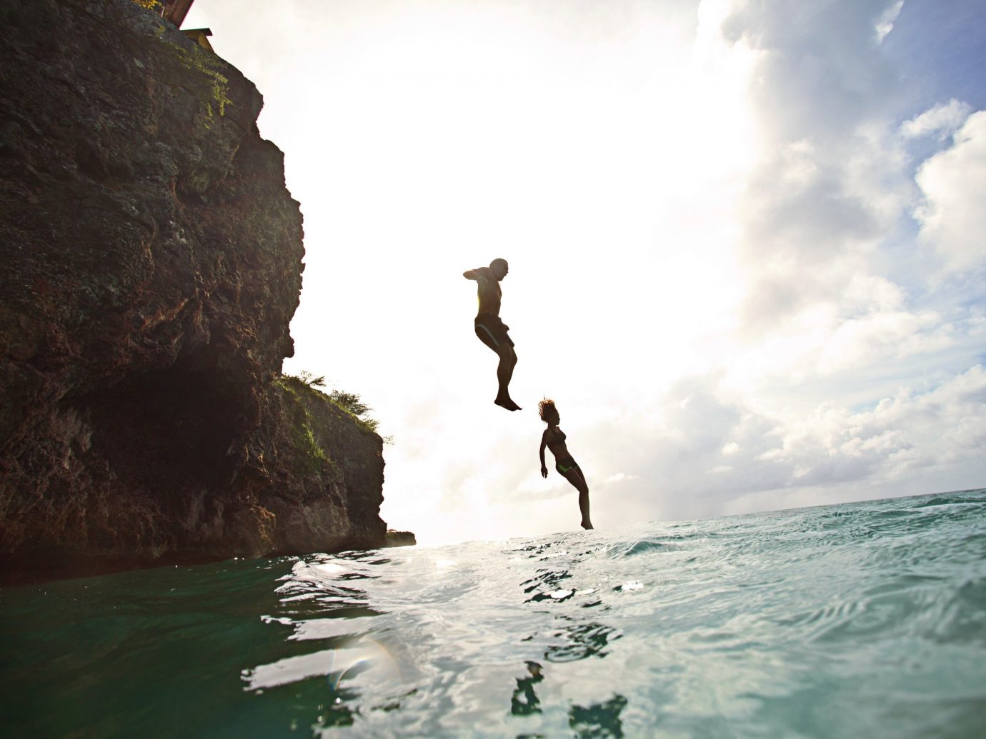 Beaches caribbean outdoor sky water Sea cliff Nature coastal and oceanic landforms wave Ocean mountain terrain water sport Coast vacation extreme sport rock jumping fun tourism wind wave hillside