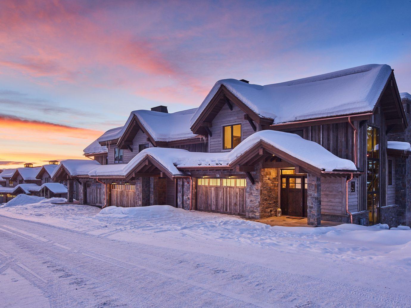 Hotels Luxury Travel Mountains + Skiing outdoor sky snow house Winter building weather season Nature home mountain estate Resort mountain range