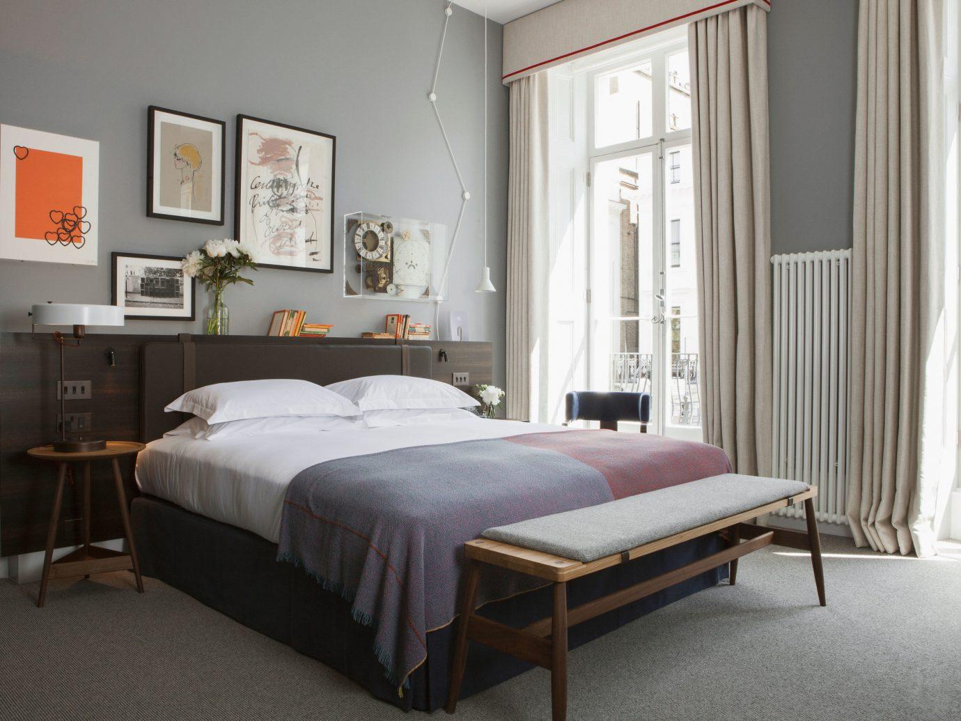 Boutique Hotels Hotels floor bed indoor wall room Bedroom property furniture hotel living room interior design bed frame home real estate Design