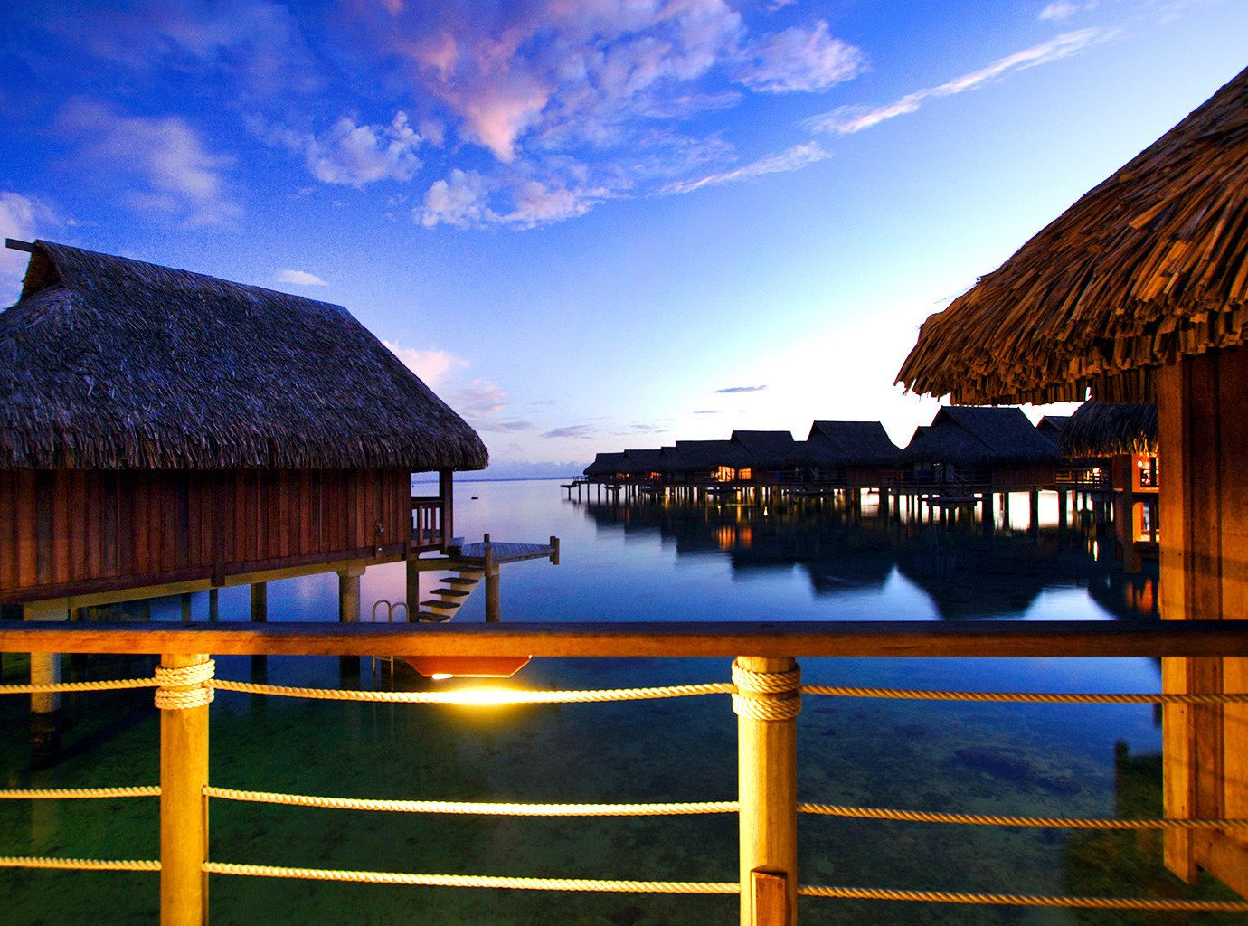 Architecture Buildings Exterior Hotels Luxury Overwater Bungalow Resort Scenic views sky outdoor water umbrella reflection Sea Ocean Sunset evening house night vacation dusk morning Coast sunlight bay
