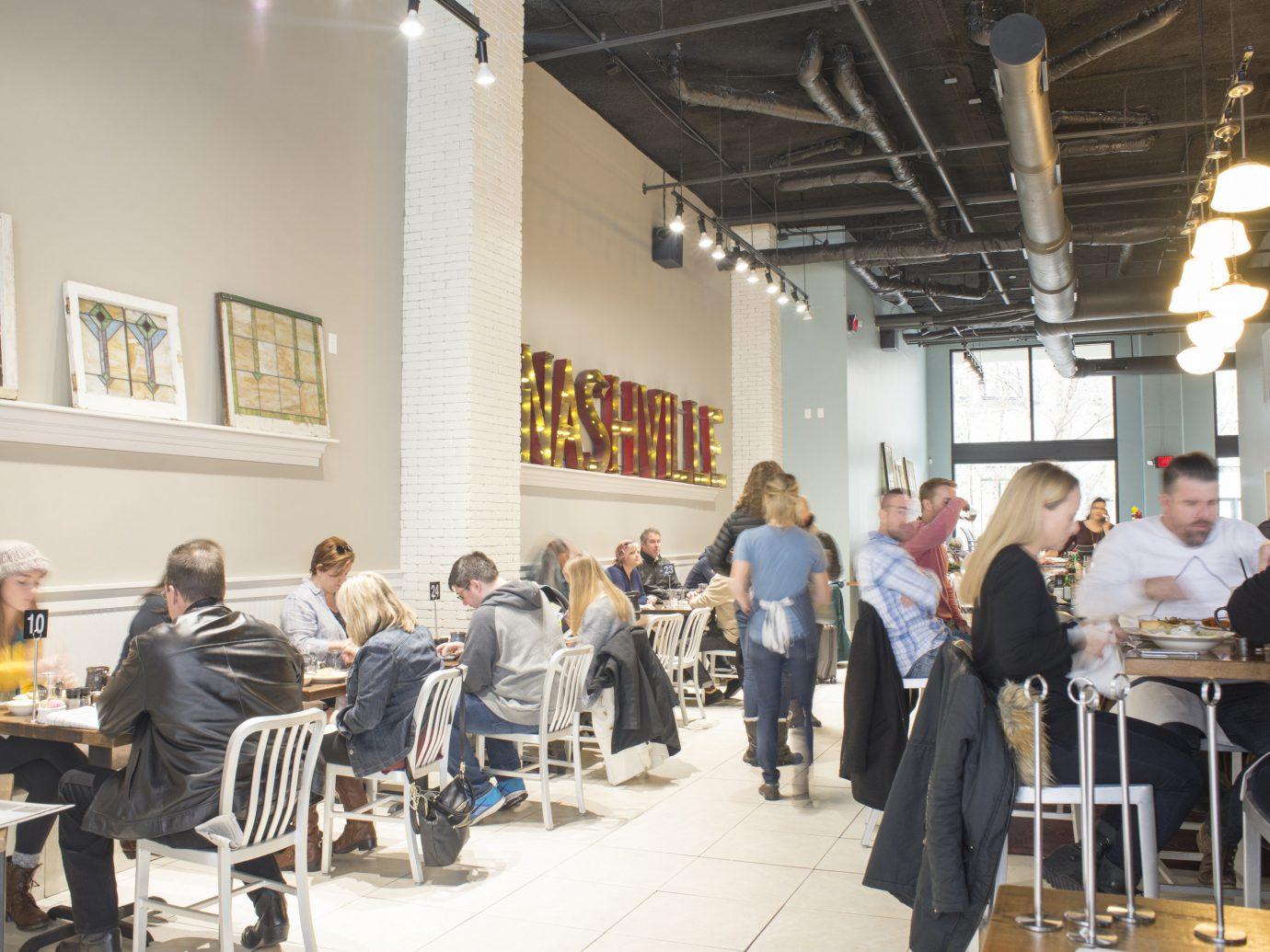 Food + Drink Trip Ideas Weekend Getaways indoor person ceiling group people meal restaurant dining table dining room