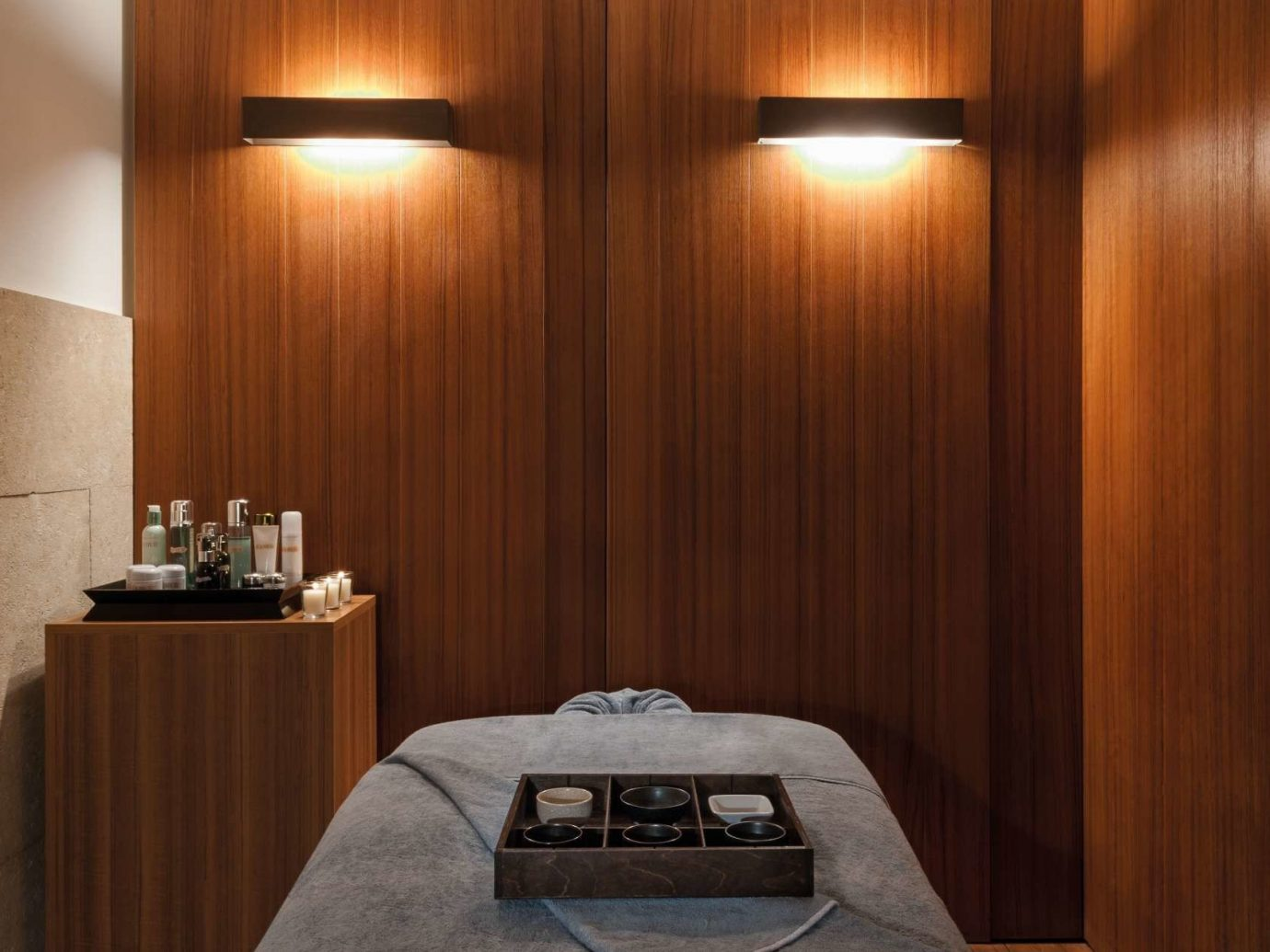 ambient lighting chic dim Health + Wellness Hotels interior lights Luxury massage moody private relaxation Spa Spa Retreats treatment wall indoor room interior design lighting Suite wood