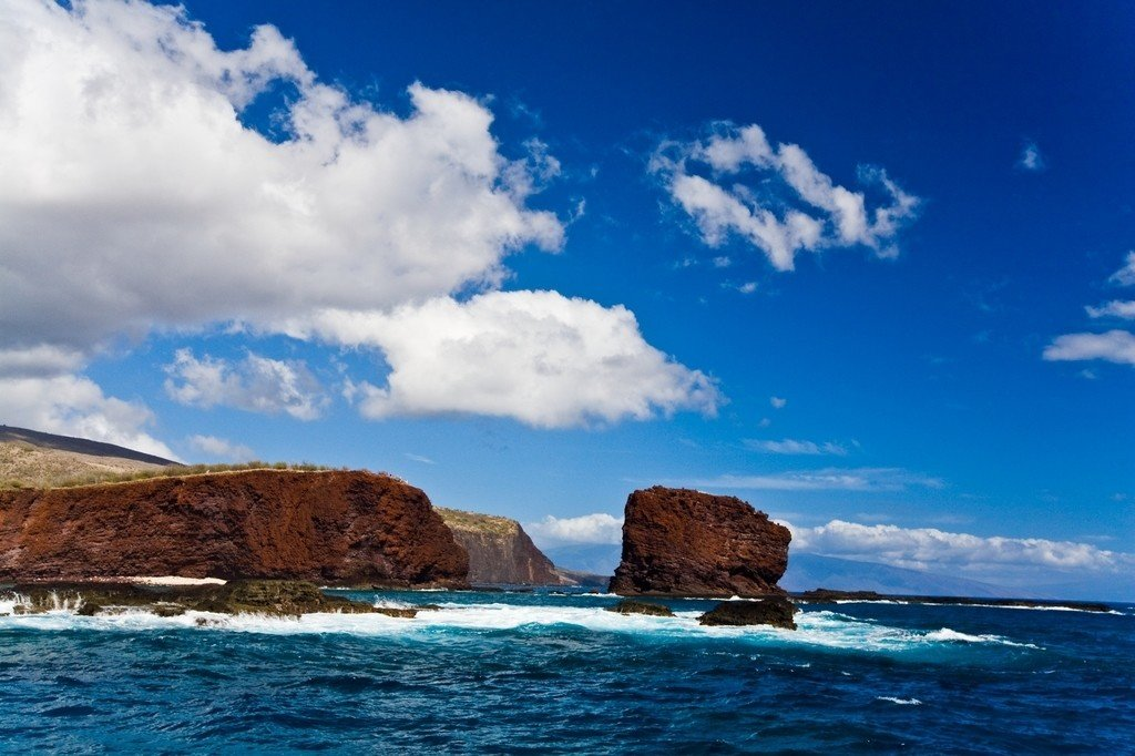 sky outdoor water Sea mountain shore Ocean Coast landform horizon Nature geographical feature body of water cloud wind wave wave rock vacation Beach cape bay islet cliff terrain promontory clouds day Island