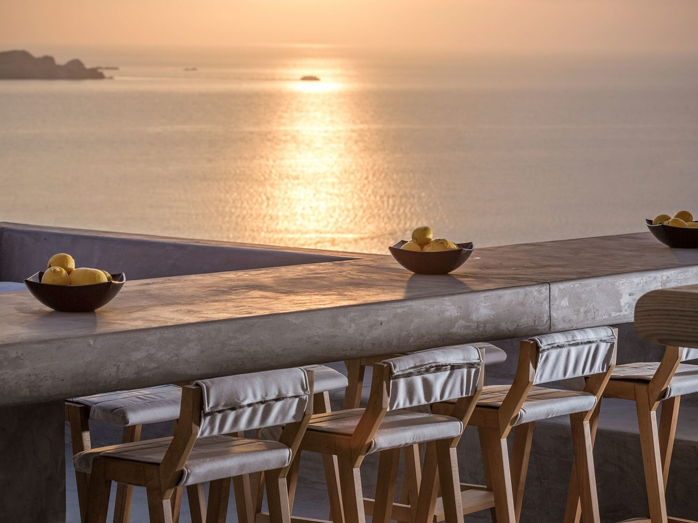 Bar Dining Drink Eat Luxury Ocean Scenic views Trip Ideas table water chair wooden room restaurant wood furniture dining table
