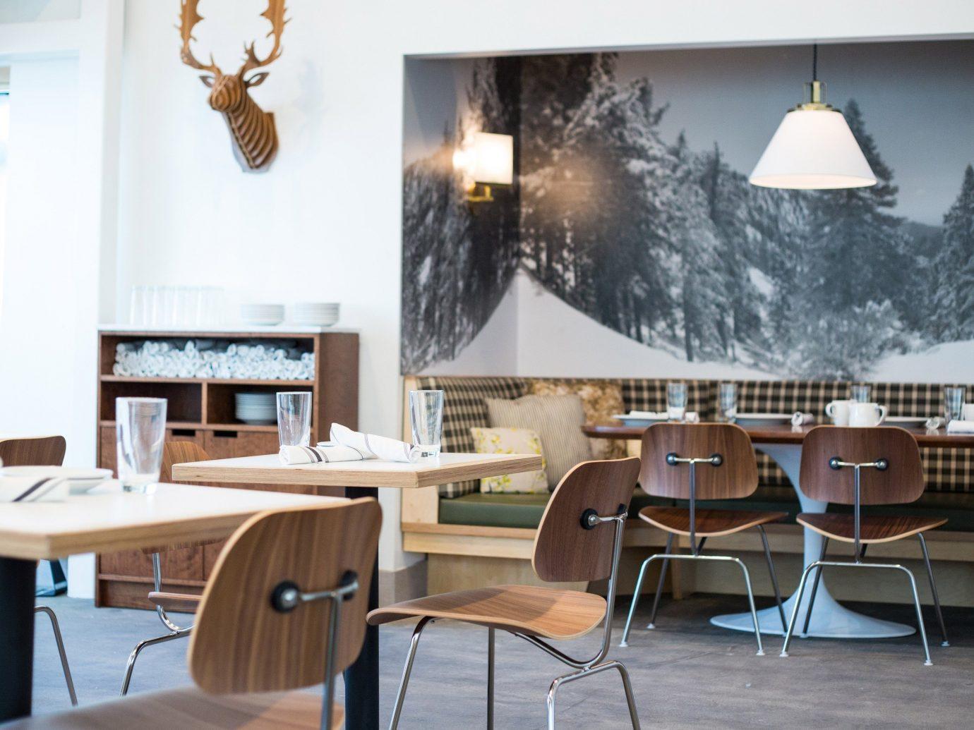 Food + Drink floor chair indoor dining room room property interior design home restaurant Design living room area furniture
