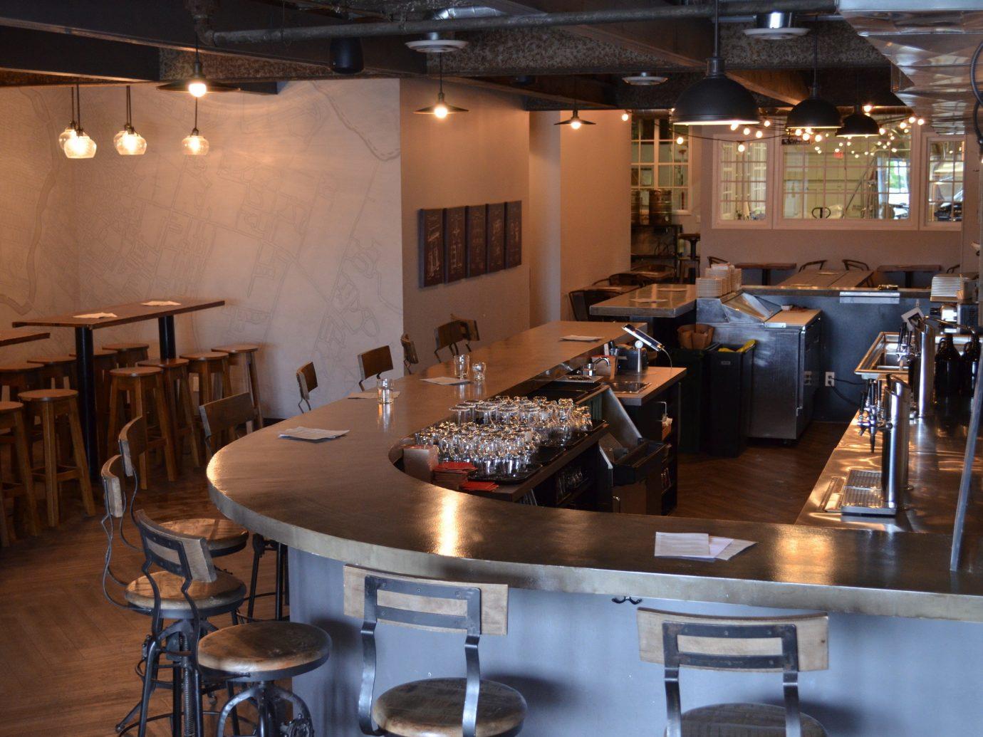 Food + Drink indoor floor table room ceiling restaurant interior design meal Design Bar café Dining furniture area dining room