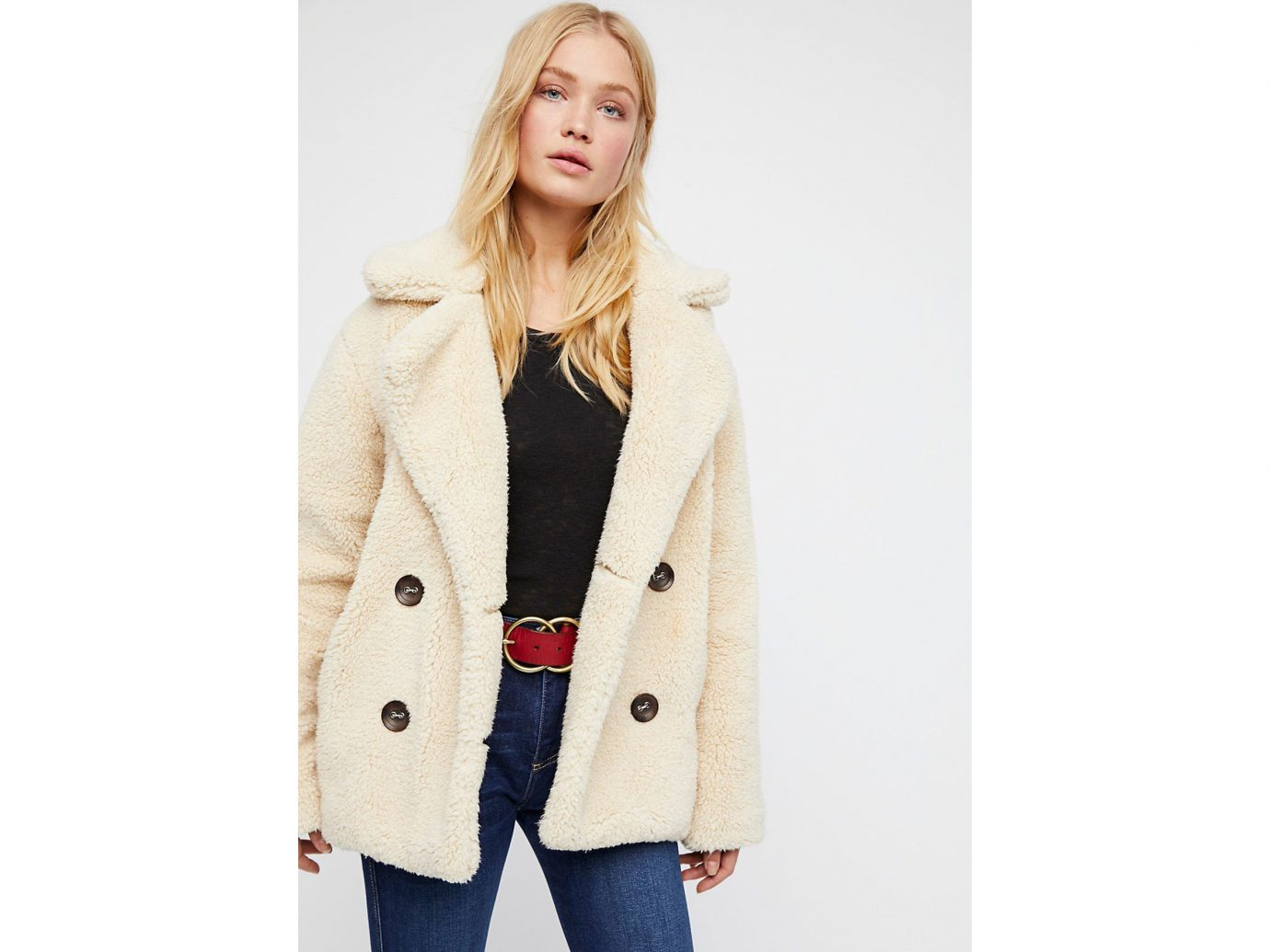 City NYC Style + Design Travel Shop clothing person coat wearing posing fashion model fur woolen overcoat beige fur clothing jacket dressed