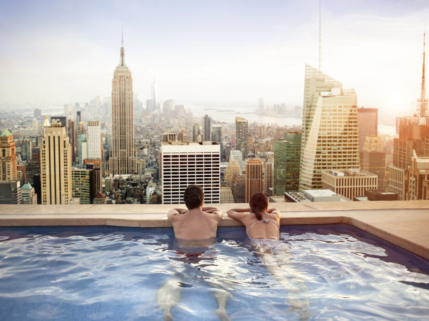 News Travel Tips Travel Trends Trip Ideas sky outdoor City human settlement skyscraper skyline Downtown plaza cityscape water feature swimming pool reflection