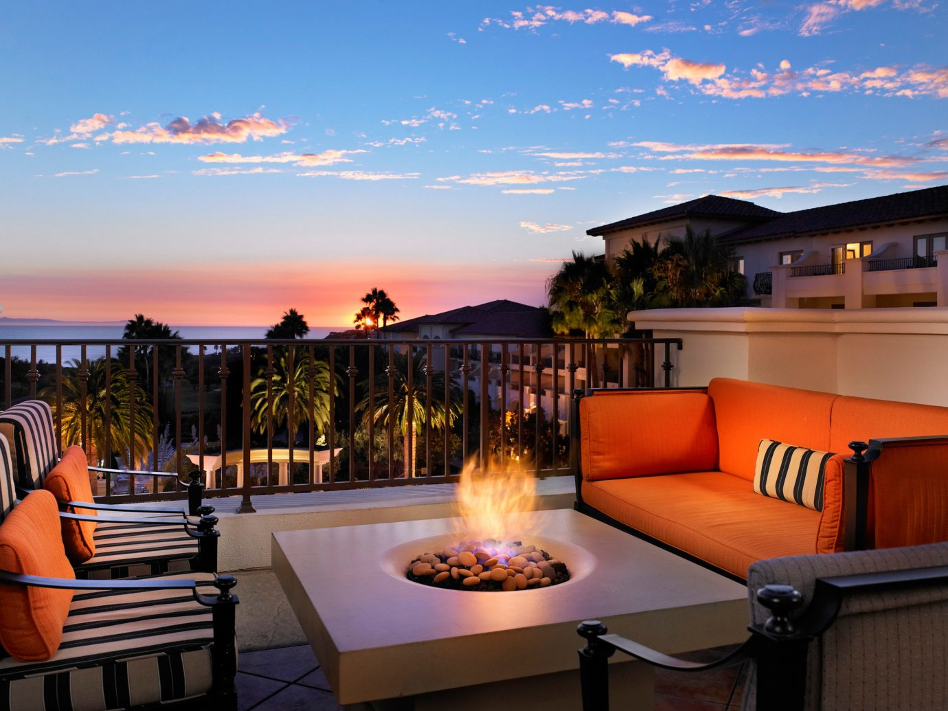 Hotels Living Lounge Luxury sky orange outdoor property estate house vacation home Resort Sunset real estate Villa setting set