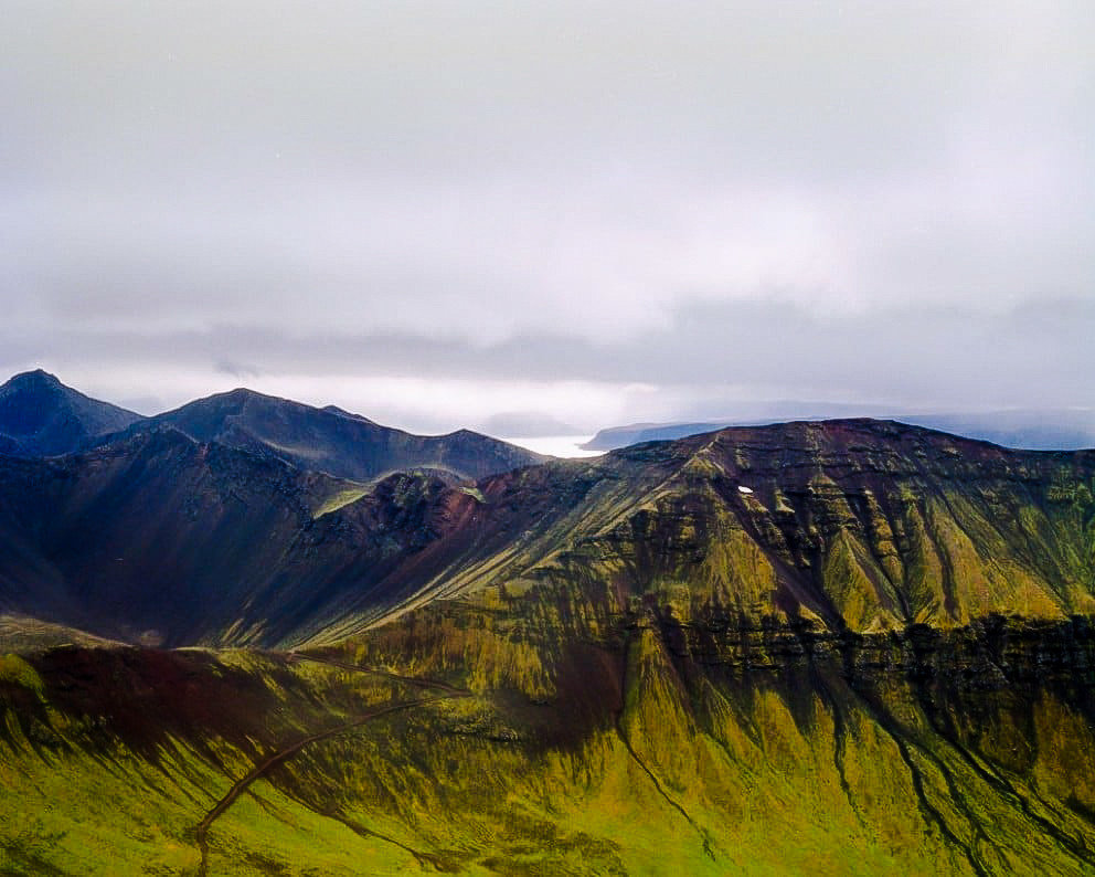 Iceland Travel Tips sky mountain Nature outdoor highland mountainous landforms grass geographical feature landform atmospheric phenomenon wilderness mountain range cloud hill fell morning loch ridge landscape rural area Lake mountain pass plateau valley alps pasture cloudy clouds hillside lush day distance