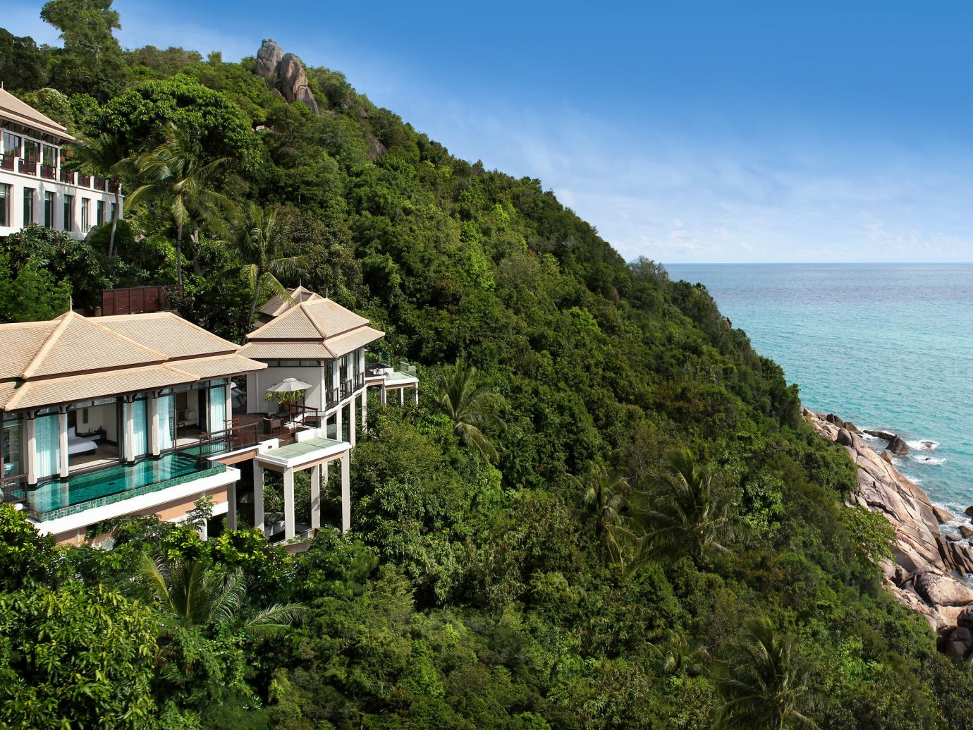 Hotels outdoor sky tree water mountain geographical feature Coast landform vacation Nature Sea Ocean cliff bay Beach terrain cape traveling hillside Island