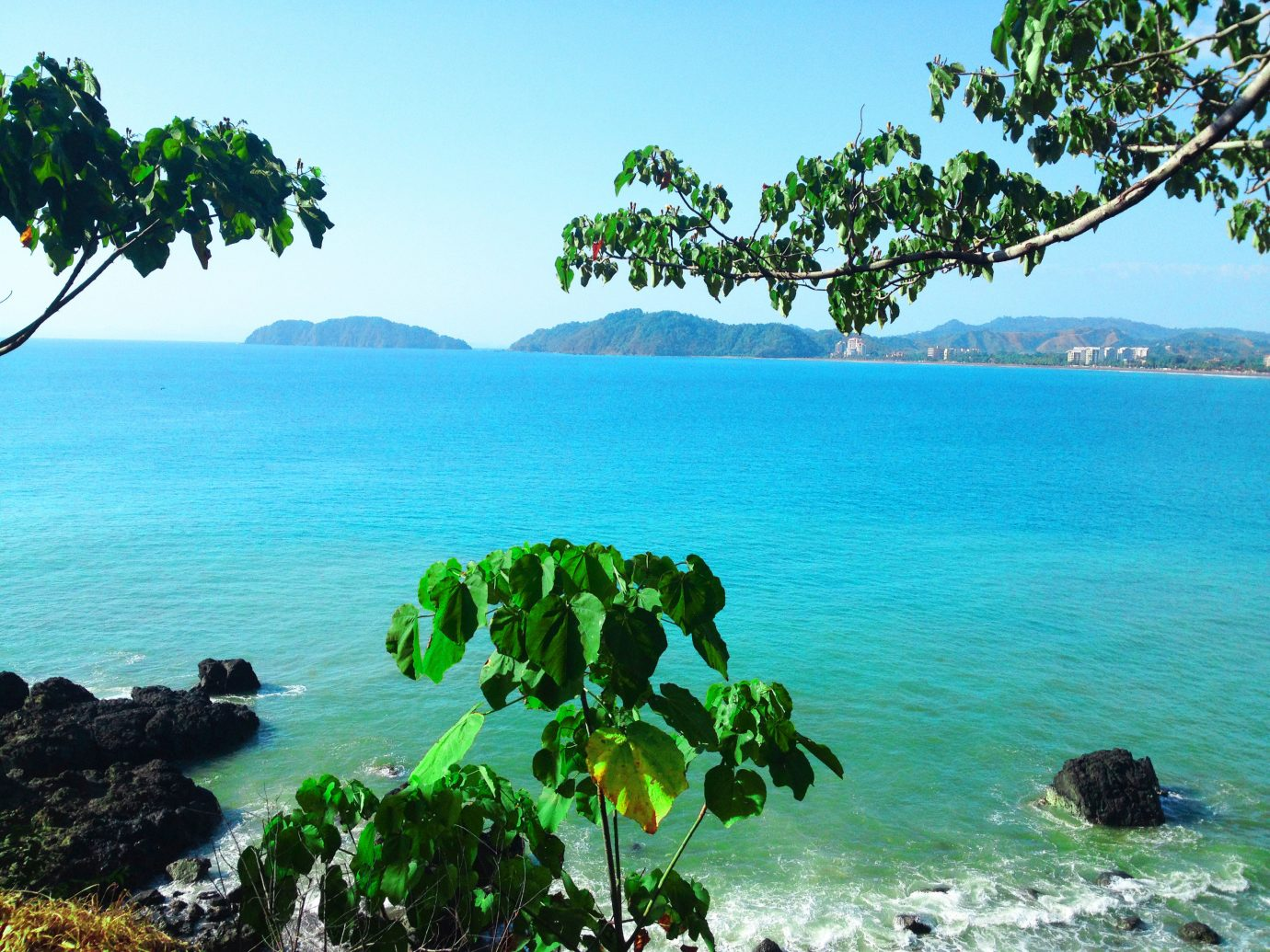 Offbeat water outdoor sky tree Sea landform geographical feature Coast Ocean Beach body of water shore Lake rock tropics caribbean Nature islet River bay archipelago Island vacation overlooking arecales Lagoon cove cape plant beautiful pond