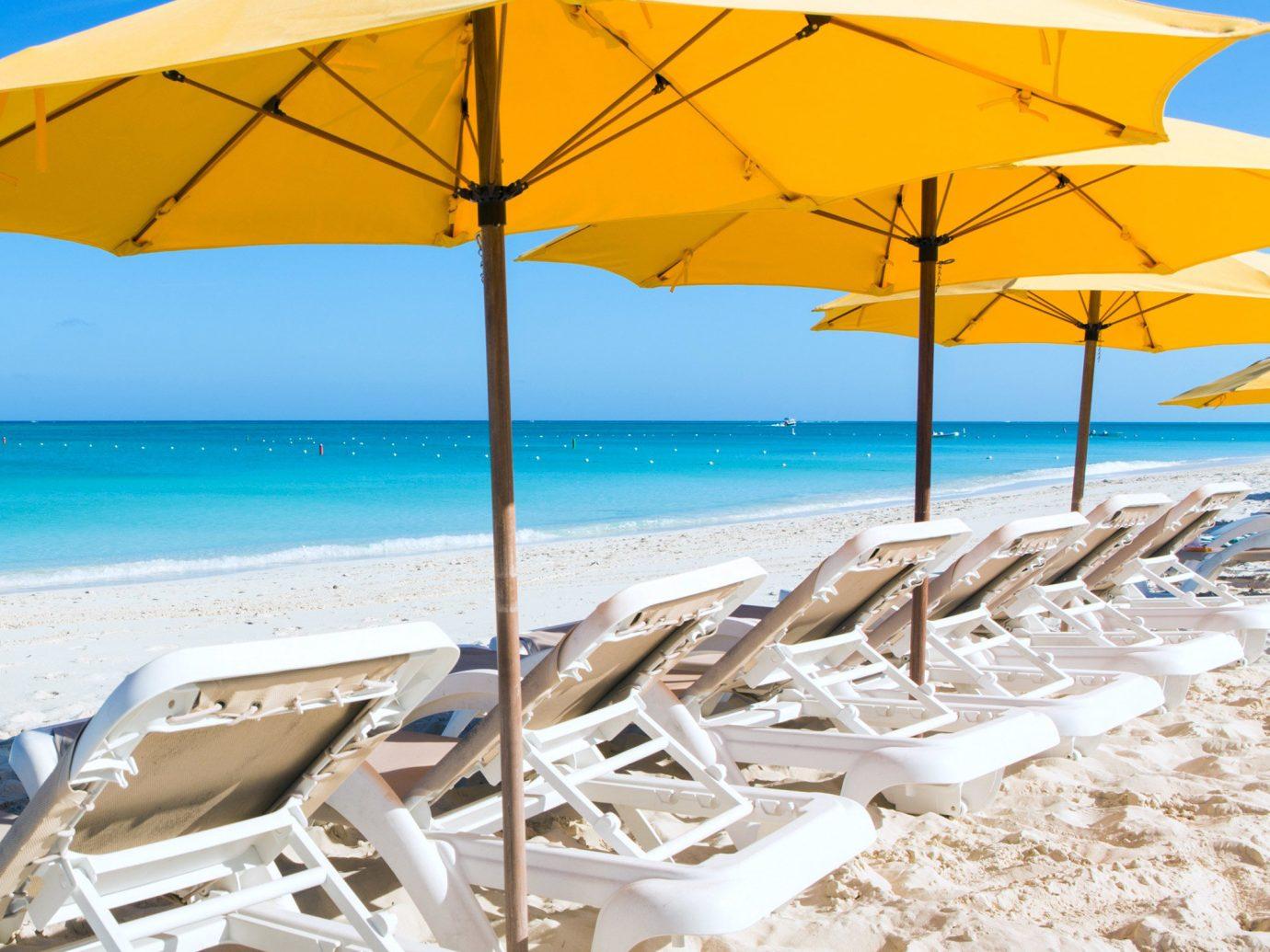 Beach Beachfront Grounds Hotels Play Resort Scenic views accessory sky umbrella outdoor chair shore Ocean Nature Sea caribbean Coast vacation
