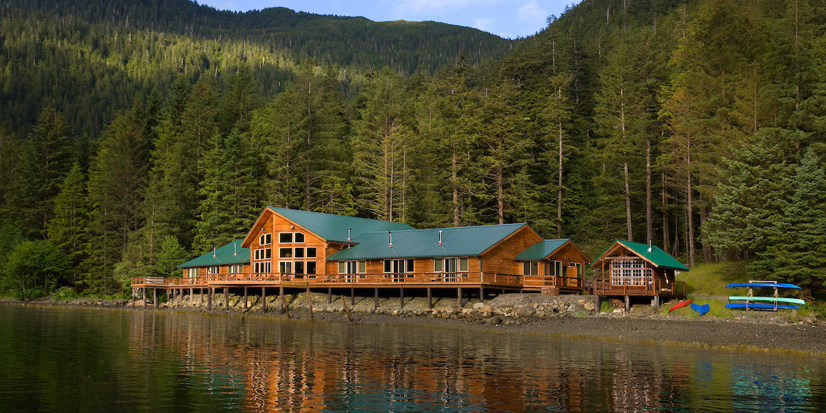All-Inclusive Resorts Family Travel Hotels reflection Nature water Lake wilderness tree cottage mountain home house plant log cabin hut reservoir biome landscape national park real estate mount scenery fjord sky loch River estate