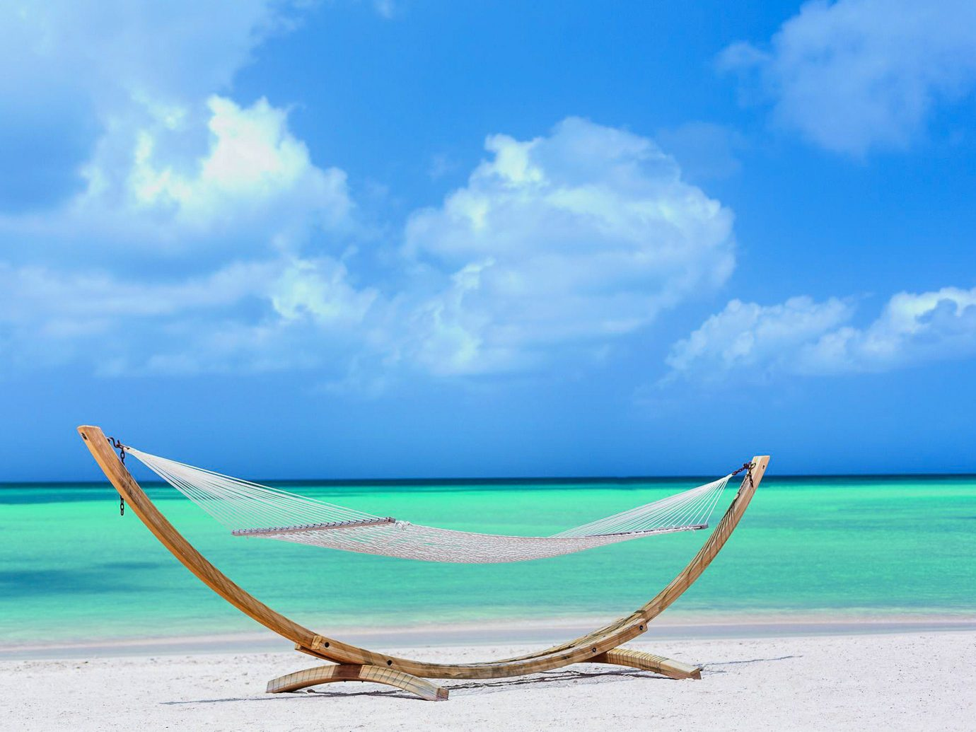Hotels Romance sky water outdoor blue Sea Beach caribbean coastal and oceanic landforms vacation Ocean shore azure tropics cloud horizon calm bed Nature wave turquoise hammock clouds sandy day distance