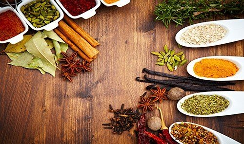 Food + Drink table plate food wooden herb wood produce spice mix flavor meal sliced several