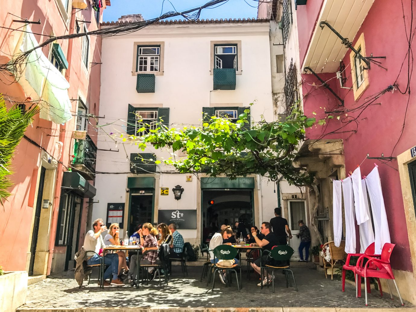Lisbon Portugal Trip Ideas neighbourhood Town street house road City facade alley window tourism tree Balcony