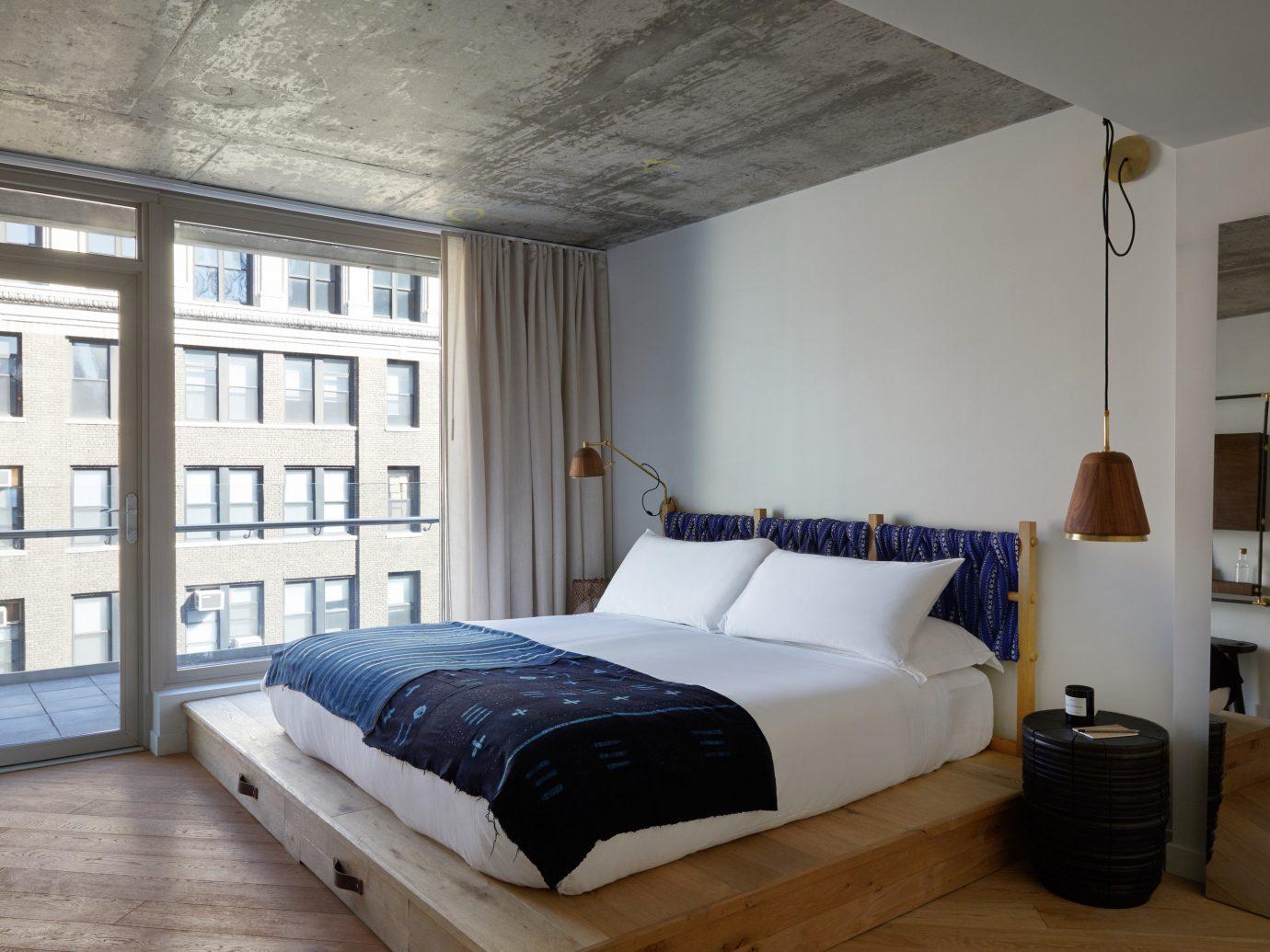 Hotels indoor wall floor room bed ceiling bed frame interior design Architecture Bedroom home window mattress furniture loft daylighting interior designer Suite hotel
