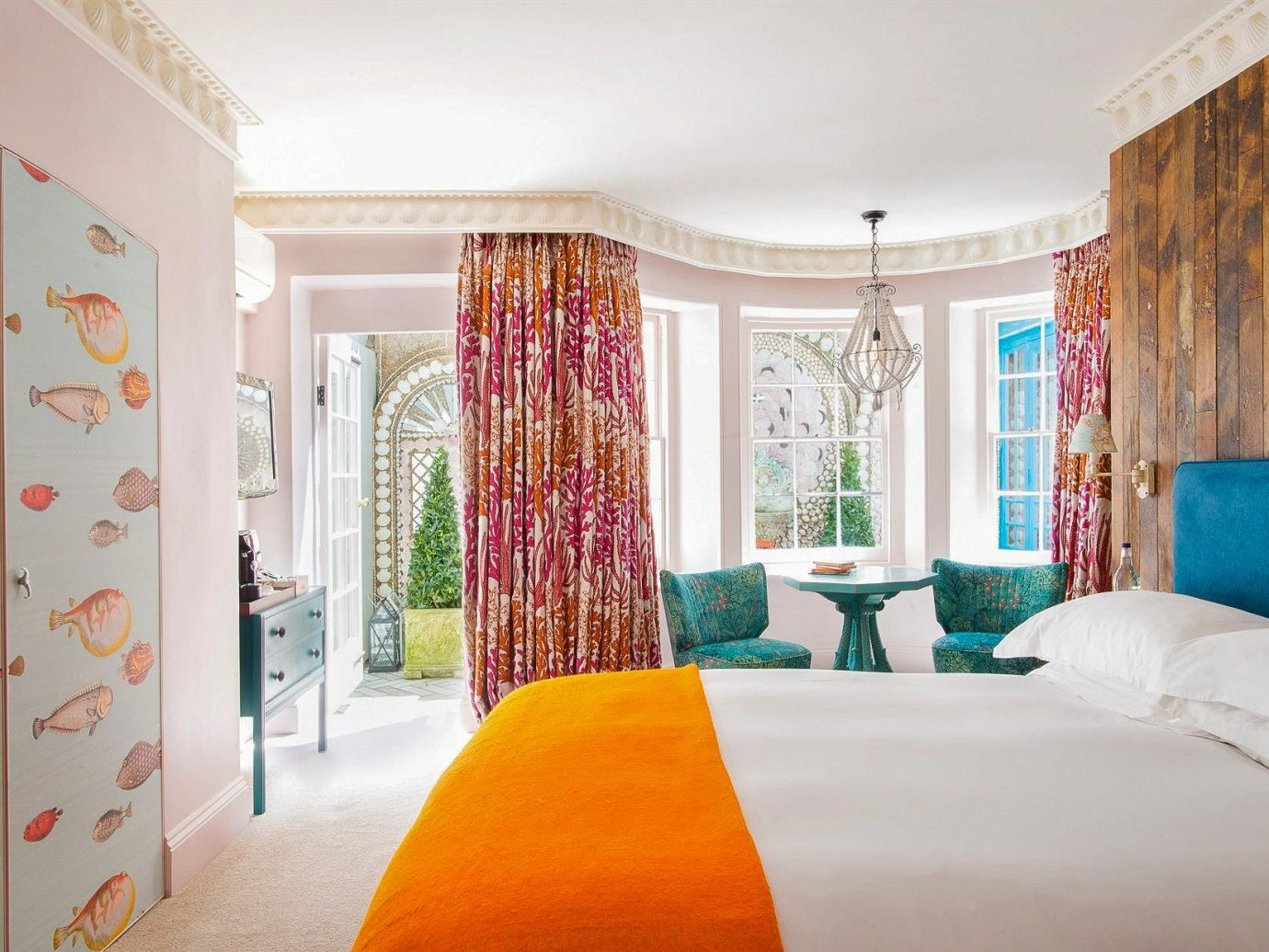 Boutique Hotels London Romantic Hotels indoor wall bed room Bedroom property interior design curtain Suite window treatment home real estate ceiling textile window white bed sheet estate hotel window covering furniture bedding interior designer apartment orange decorated bed frame living room