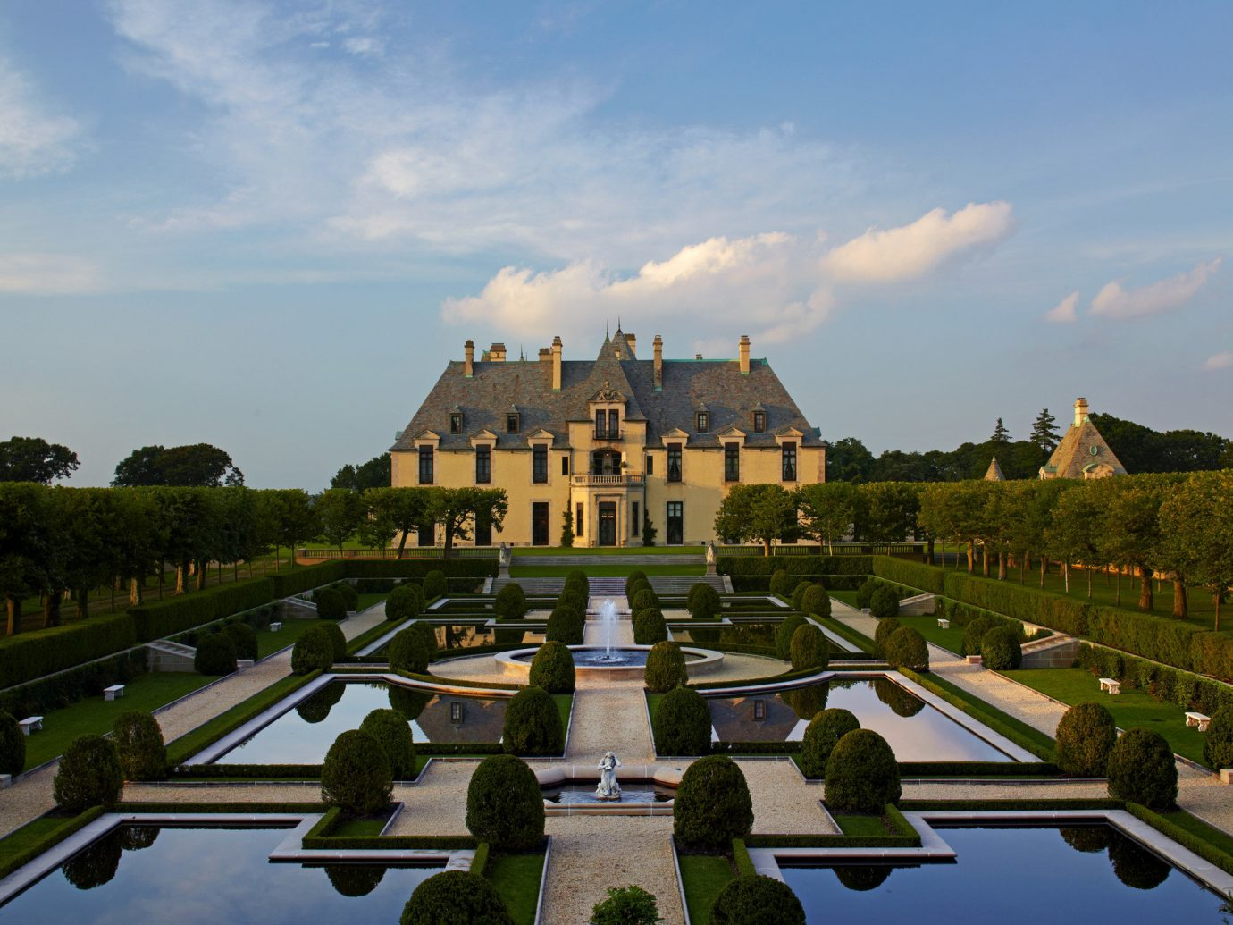 Hotels Trip Ideas sky outdoor landmark building City estate château reflecting pool vacation palace tourism reflection town square cityscape Garden park road day highway