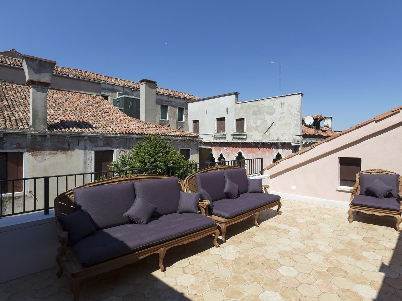 Hotels Italy Luxury Travel Venice property roof apartment real estate house Balcony residential area estate building window penthouse apartment outdoor structure daylighting angle Villa facade sky