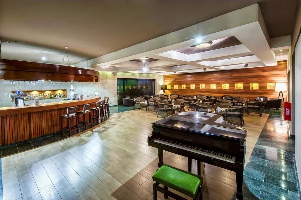 All-Inclusive Resorts Hotels Romance floor indoor ceiling property restaurant Bar Lobby interior design real estate estate wood meal cafeteria furniture area Island