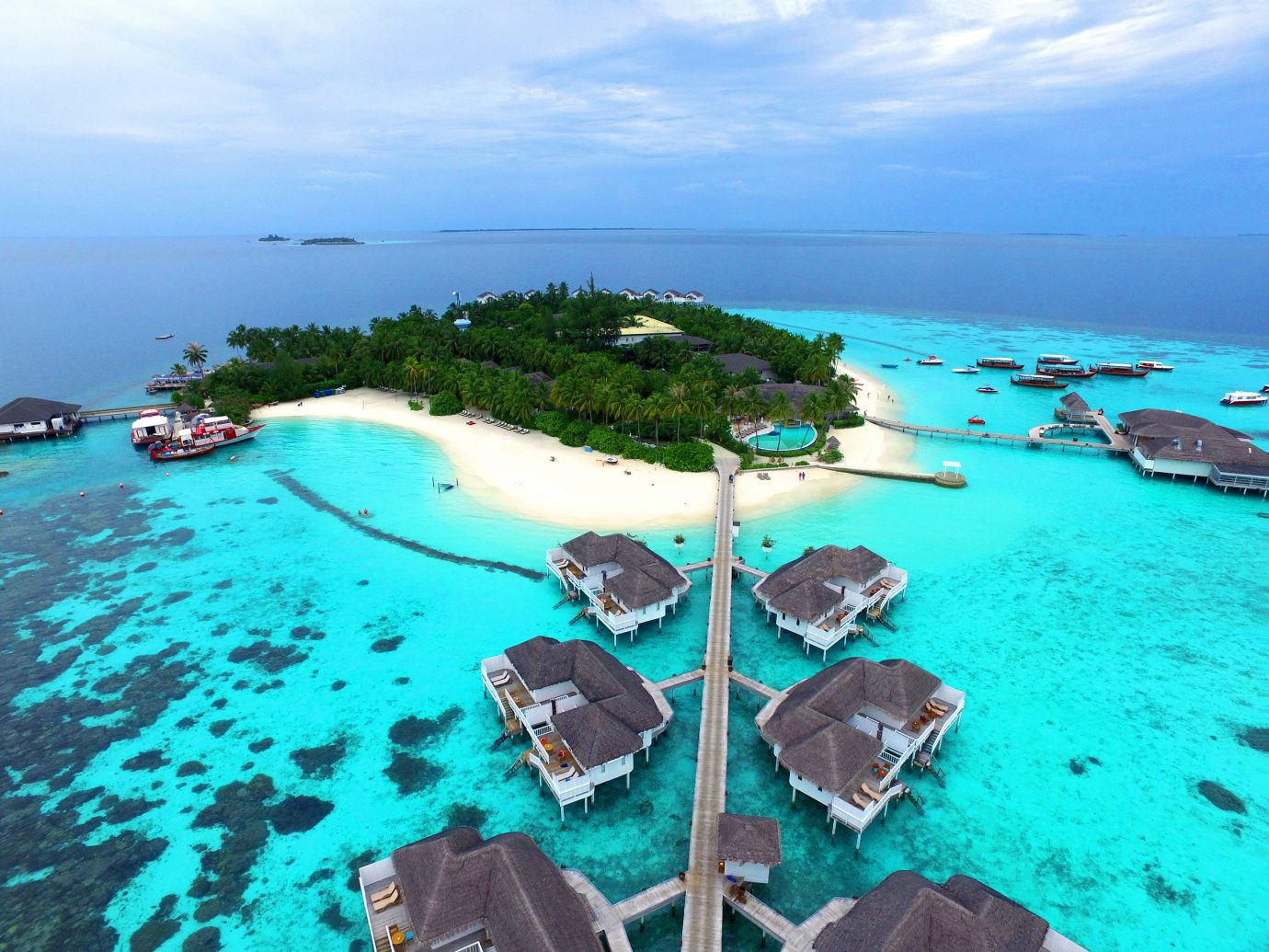 All-Inclusive Resorts Hotels sky water coastal and oceanic landforms outdoor Nature Sea Island promontory caribbean islet archipelago Lagoon tourism vacation tropics Resort bay Ocean swimming pool resort town reef Coast leisure atoll day