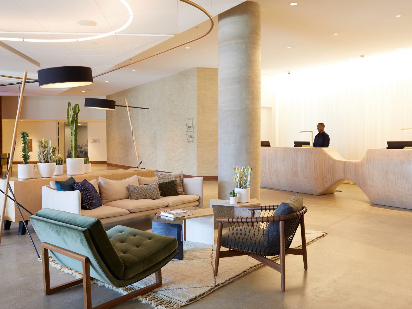 Arts + Culture Hotels Jetsetter Guides shopping Travel Trends Trip Ideas floor indoor wall room Living living room interior design ceiling Lobby real estate table flooring furniture interior designer loft house apartment penthouse apartment area