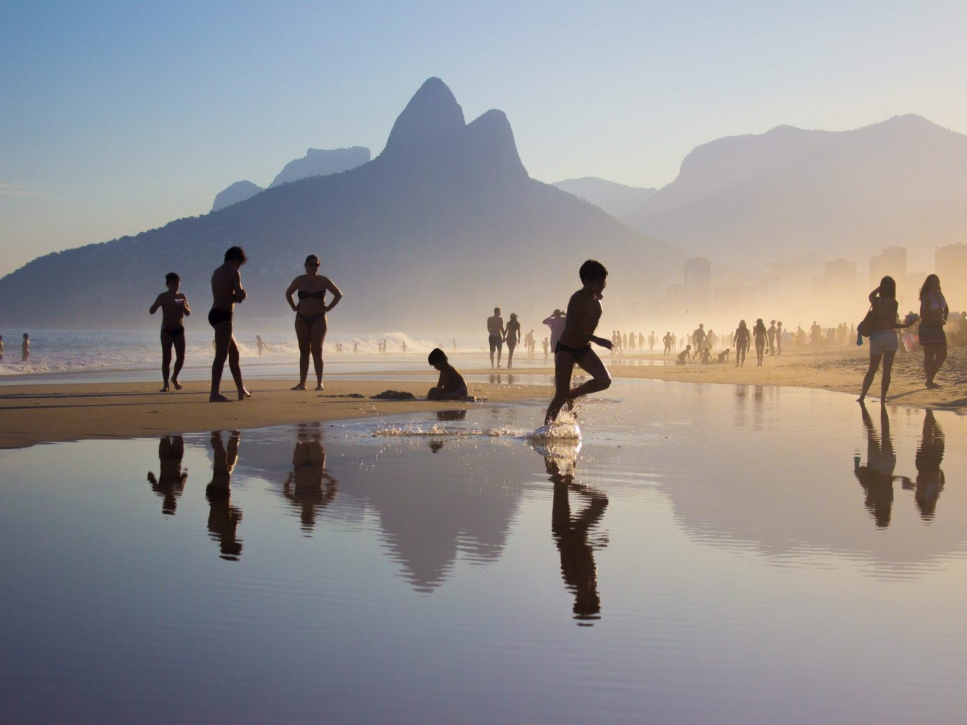Offbeat outdoor water sky Nature atmospheric phenomenon reflection natural environment Beach mountain morning Sea people landscape dawn sand shore several