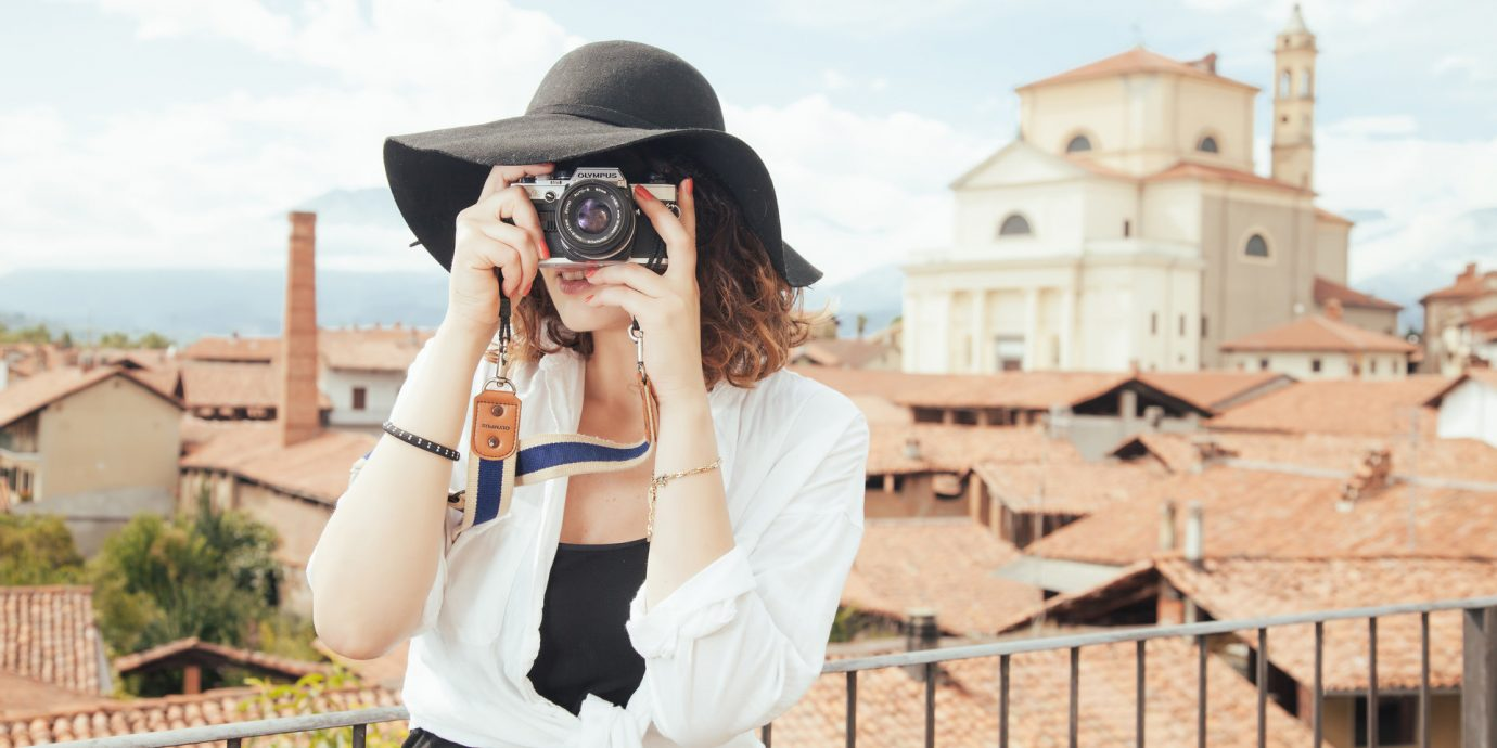 Buildings camera charming City city views europe Ocean ocean view people photography quaint rooftops sun hat tourist Town Travel Tech Travel Tips view viewpoint woman sky outdoor person clothing spring anime