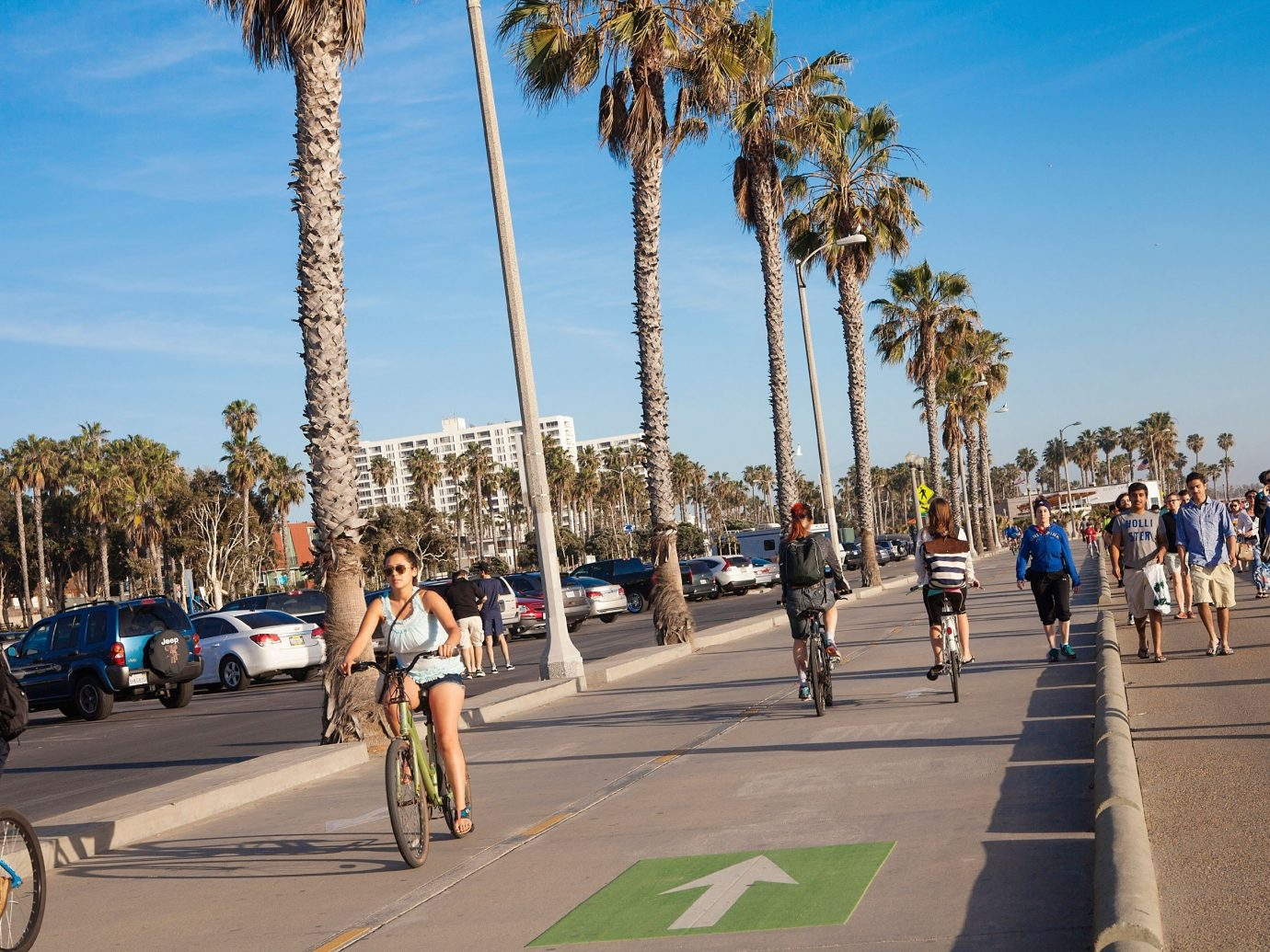 Budget sky road outdoor person walkway boardwalk street sports tourism cycling endurance sports people endurance athletics pedestrian palm