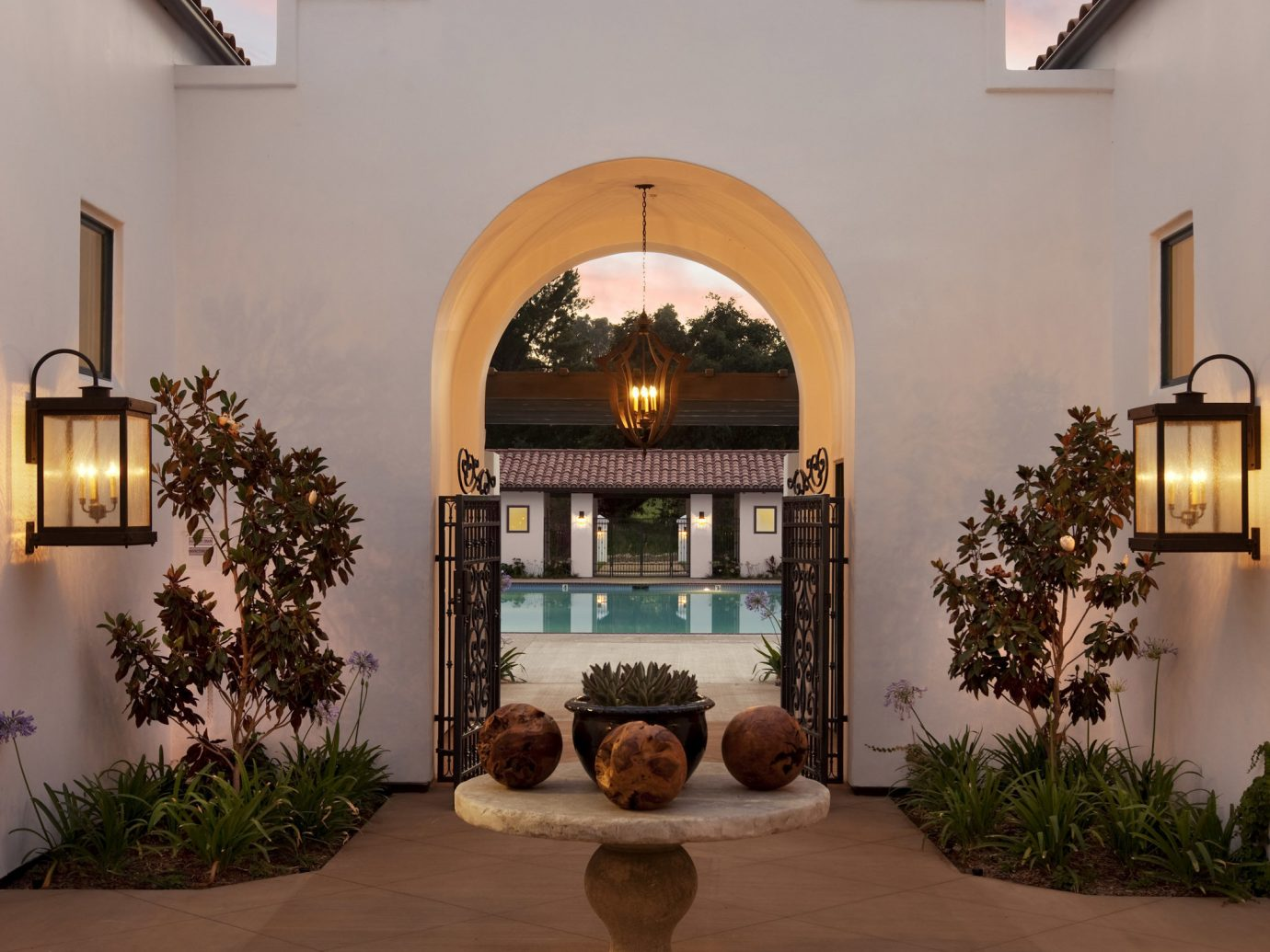 Style + Design property house building outdoor estate home Architecture living room arch interior design mansion hacienda wood Villa Courtyard ceiling hearth stone