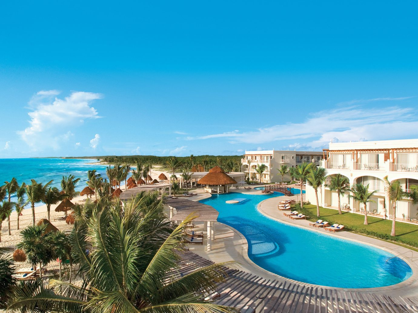 Hotels Romance sky Resort outdoor swimming pool property leisure Beach vacation Pool caribbean estate Lagoon Nature bay resort town Sea real estate reef blue colorful shore swimming sandy