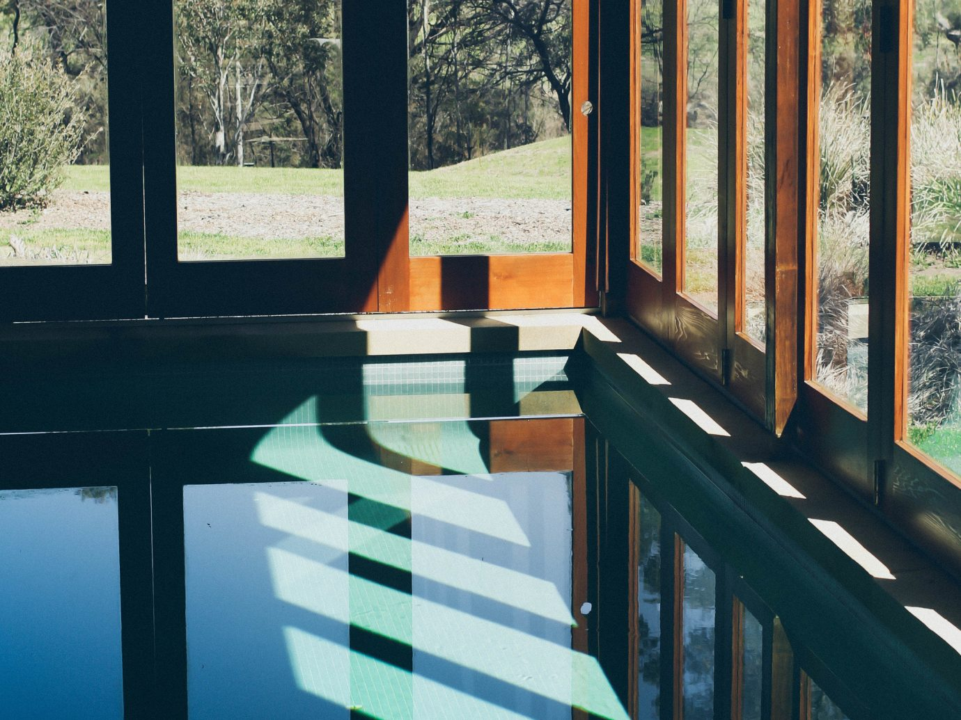 Trip Ideas color blue house Architecture home window interior design estate wood reflection sunlight Design window covering colorful colored