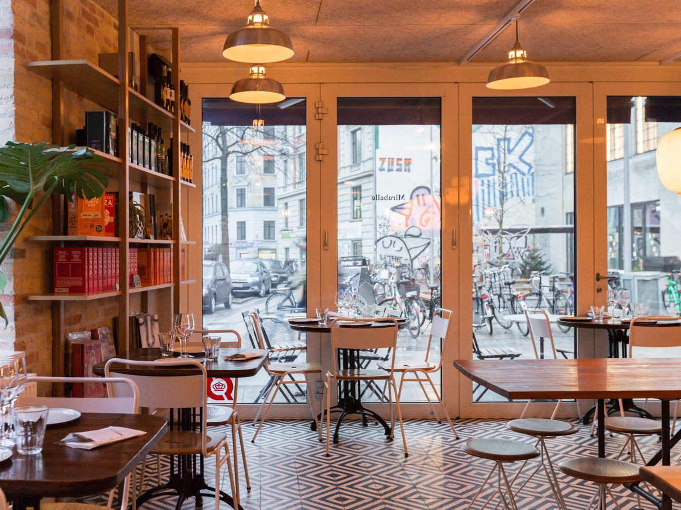 Copenhagen Denmark Trip Ideas table chair indoor restaurant interior design window café furniture Dining coffeehouse dining room area dining table