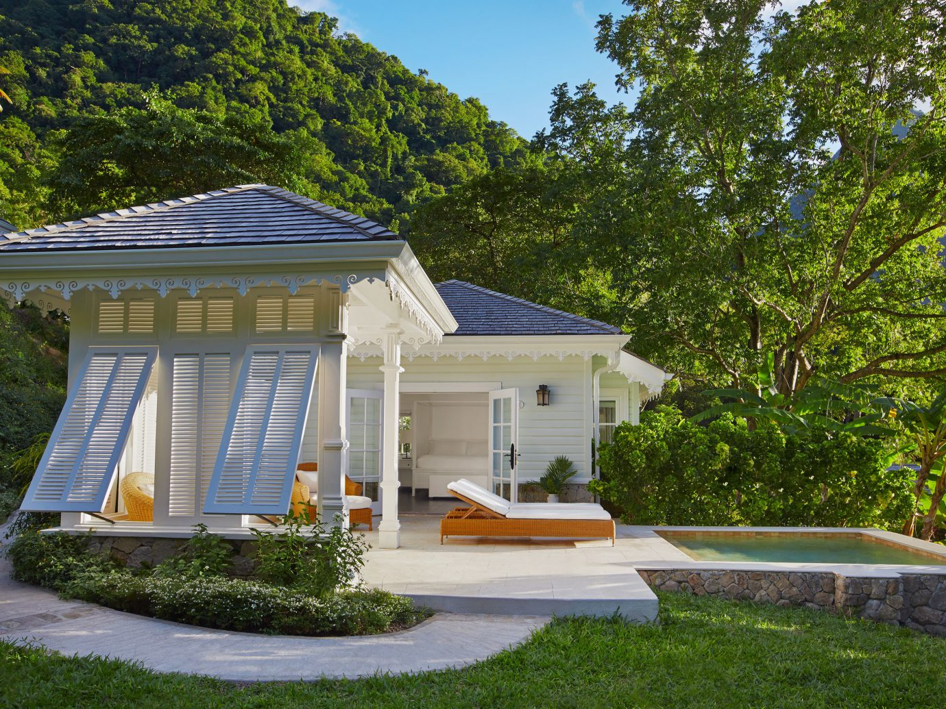 Architecture Buildings Design Exterior Family Hotels Luxury Resort Romance tree outdoor grass house property building home estate backyard cottage Villa real estate pavilion outdoor structure gazebo lawn mansion Garden log cabin yard stone