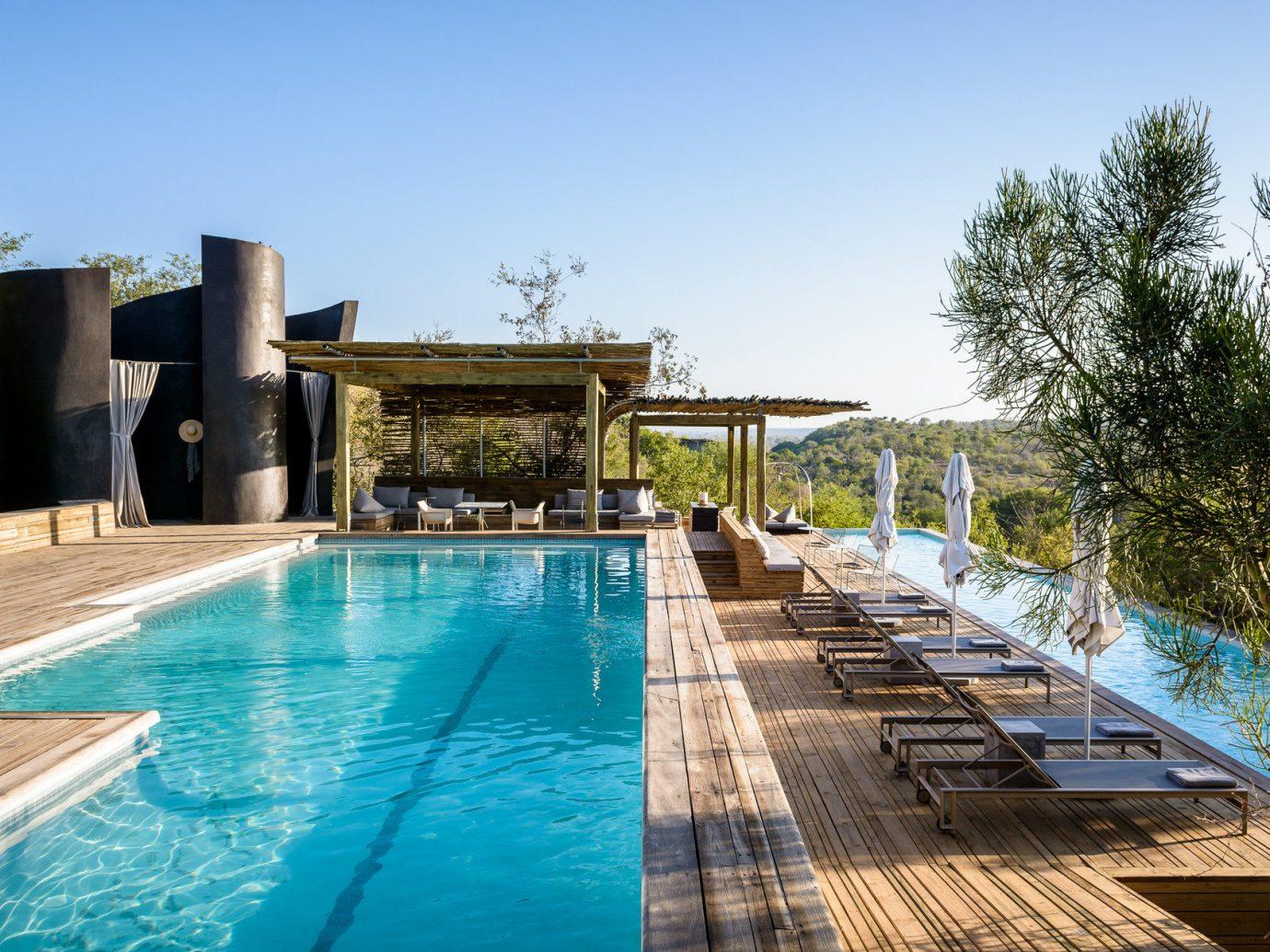 Hotels sky outdoor tree swimming pool leisure property estate Pool vacation Resort Villa real estate backyard condominium
