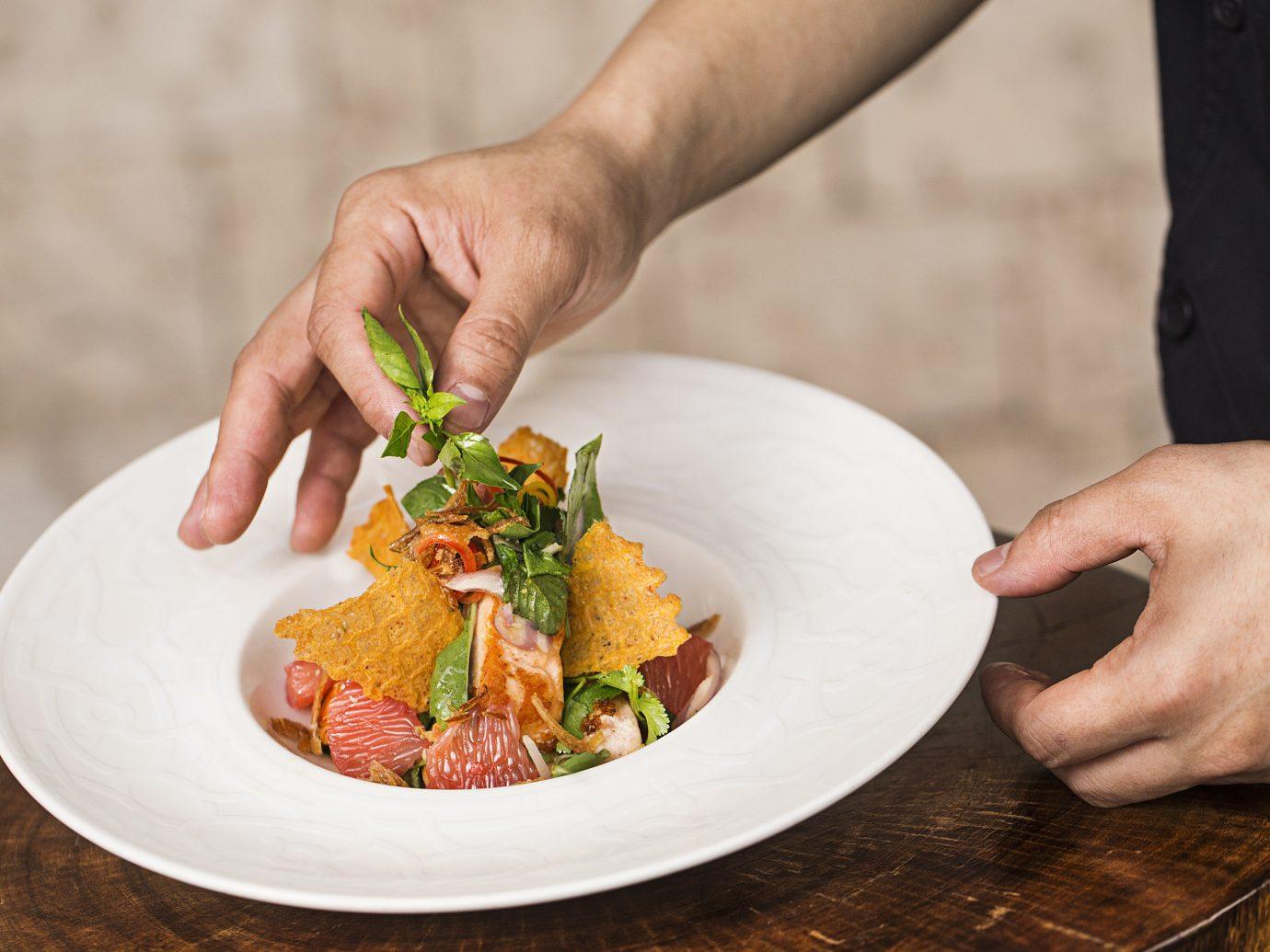 Hotels Weekend Getaways person plate food dish meal vegetable produce cuisine sense meat snack food