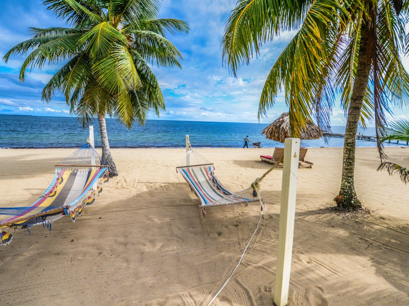 Trip Ideas tree Beach outdoor palm water ground leisure body of water caribbean vacation Sea sandy Ocean arecales tropics Resort Coast swimming pool bay lawn sand lined walkway shade palm family Lagoon shore plant line