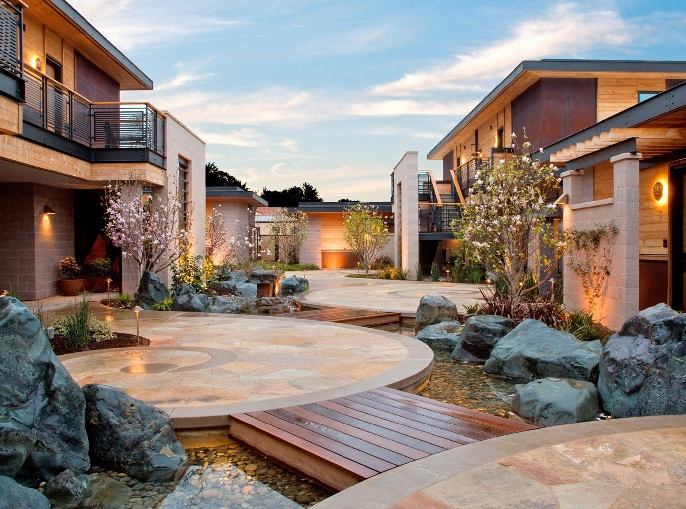 Hotels building outdoor sky property estate home house backyard rock Courtyard real estate residential area facade yard landscape swimming pool stone Villa mansion outdoor structure cottage landscaping condominium Resort Patio paving